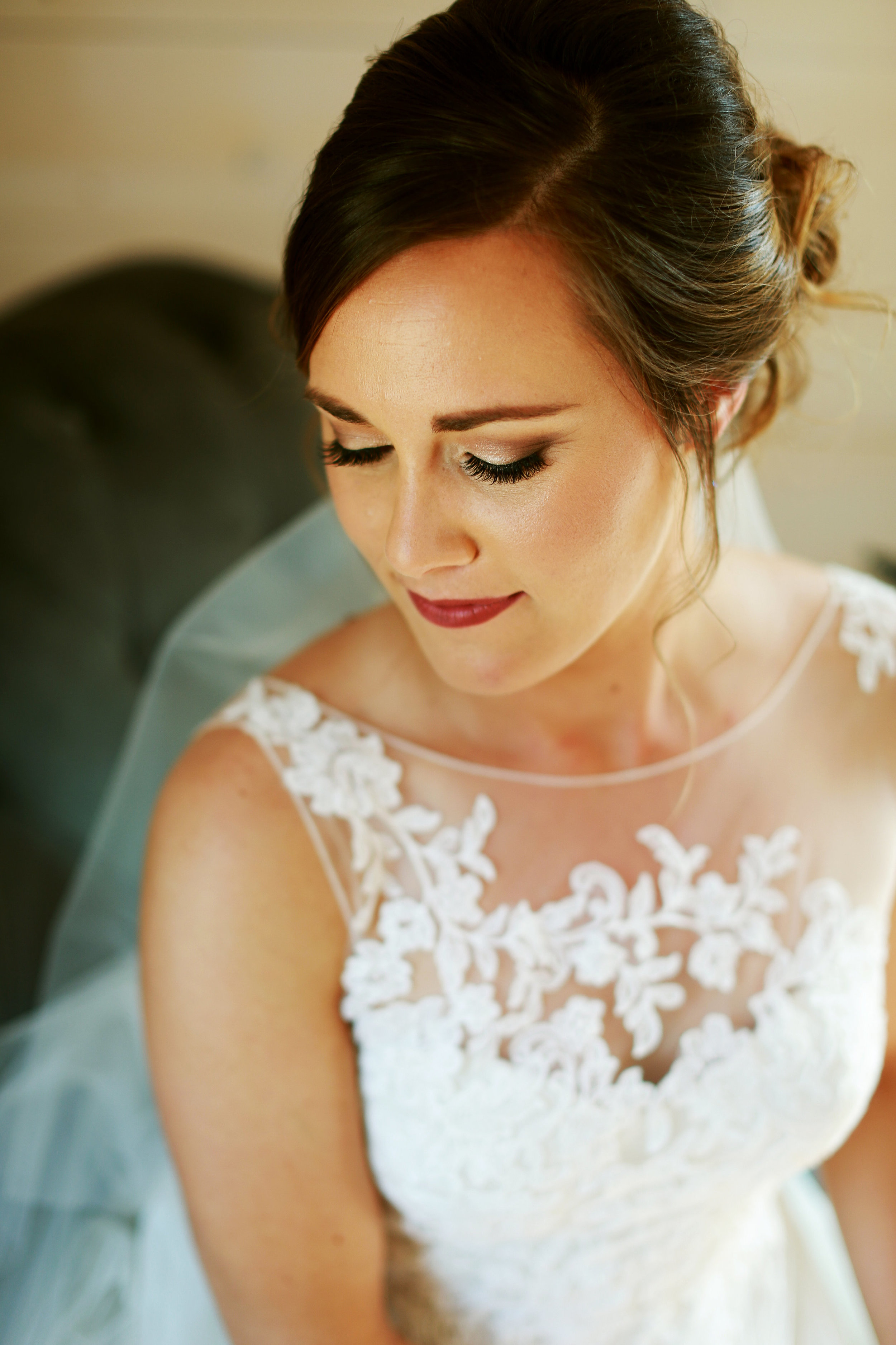 Jenna Kevin Wedding   Sixpence Events day of coordinating   Hannah Schmitt Photography   Legacy Hill Farm   bridal beauty shot   lace sheer top with low bun and perfect gold smoky eye