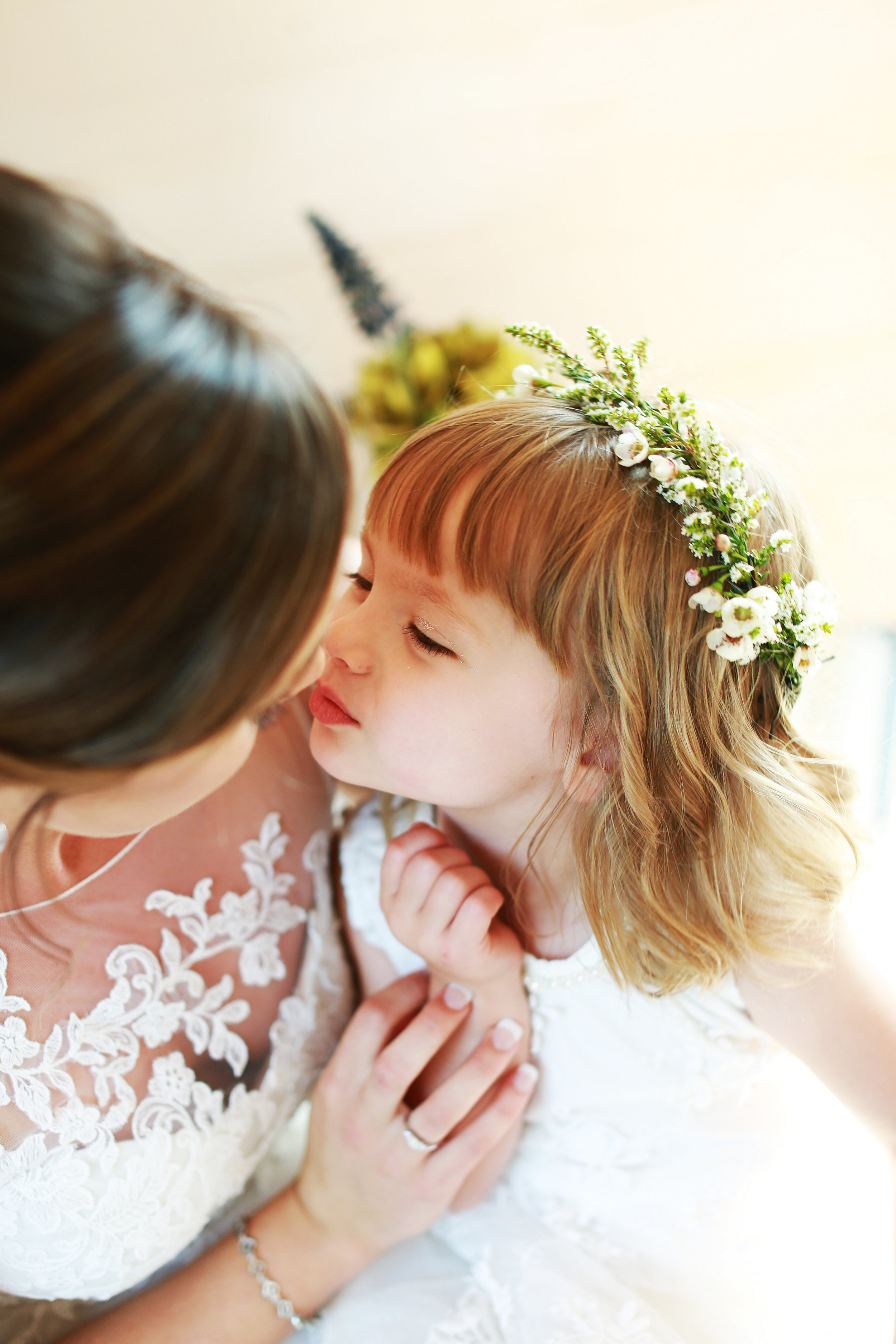 Jenna Kevin Wedding   Sixpence Events day of coordinating   Hannah Schmitt Photography   Legacy Hill Farm   flower girl with greenery crown with wax flowers