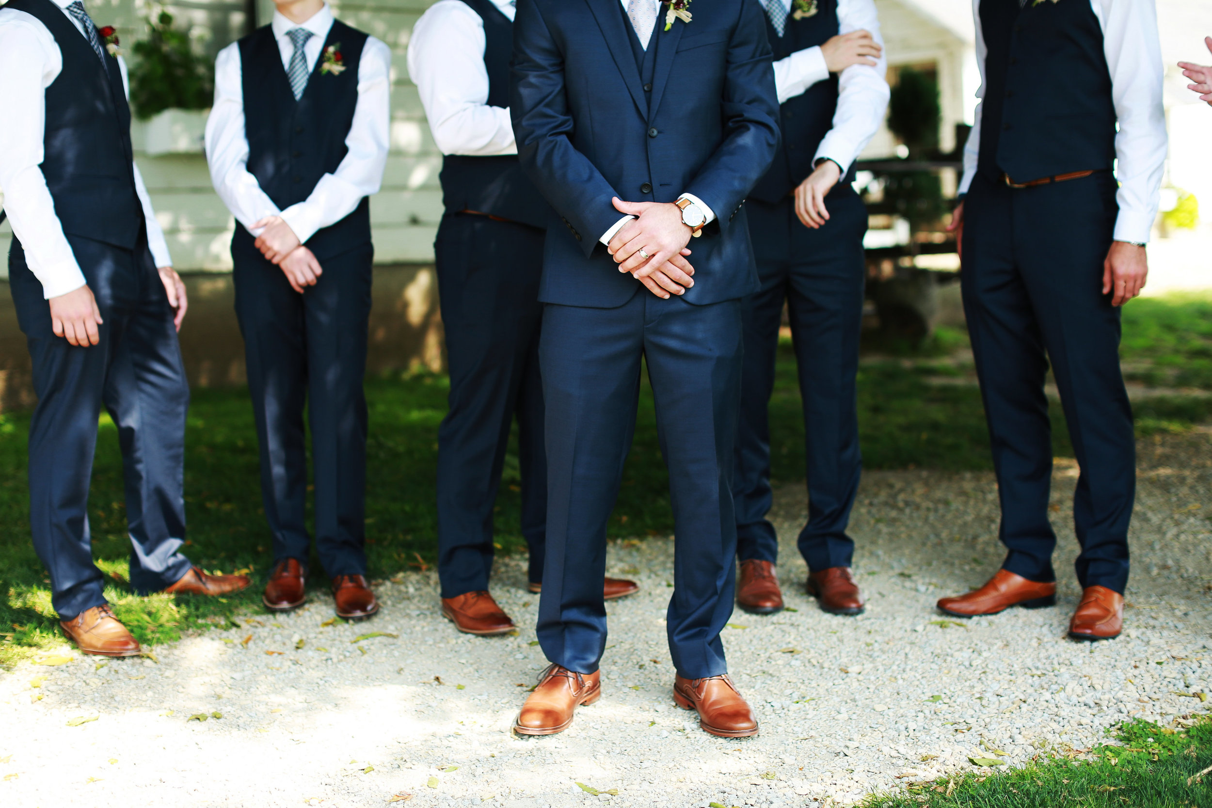 Jenna Kevin Wedding   Sixpence Events day of coordinating   Hannah Schmitt Photography   Legacy Hill Farm   groomsmen with navy vests and striped ties and brown shoes