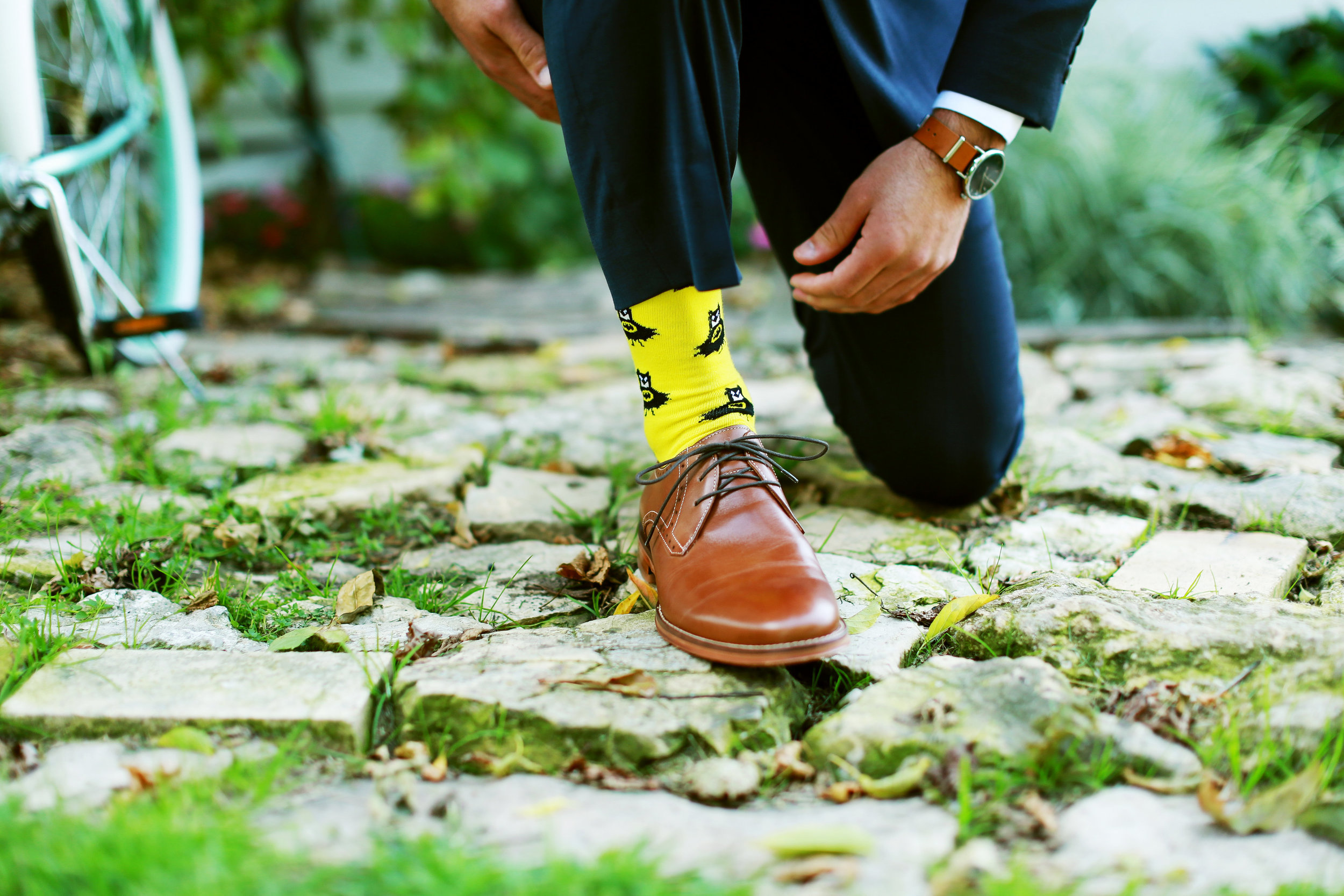 Jenna Kevin Wedding   Sixpence Events day of coordinating   Hannah Schmitt Photography   Legacy Hill Farm   groom with yellow batman socks and brown accessories
