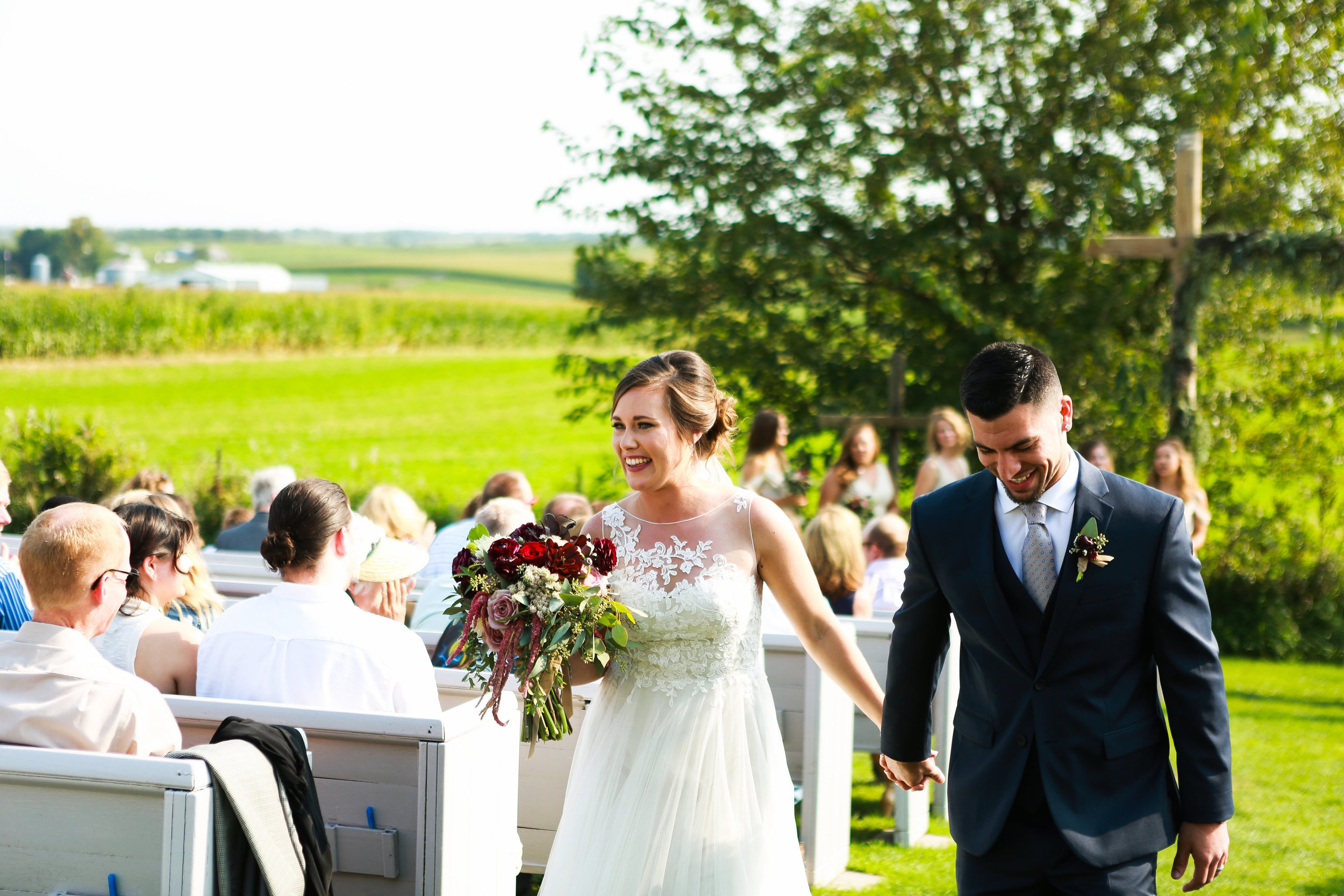 Jenna Kevin Wedding   Sixpence Events day of coordinating   Hannah Schmitt Photography   Legacy Hill Farm   just married recessional