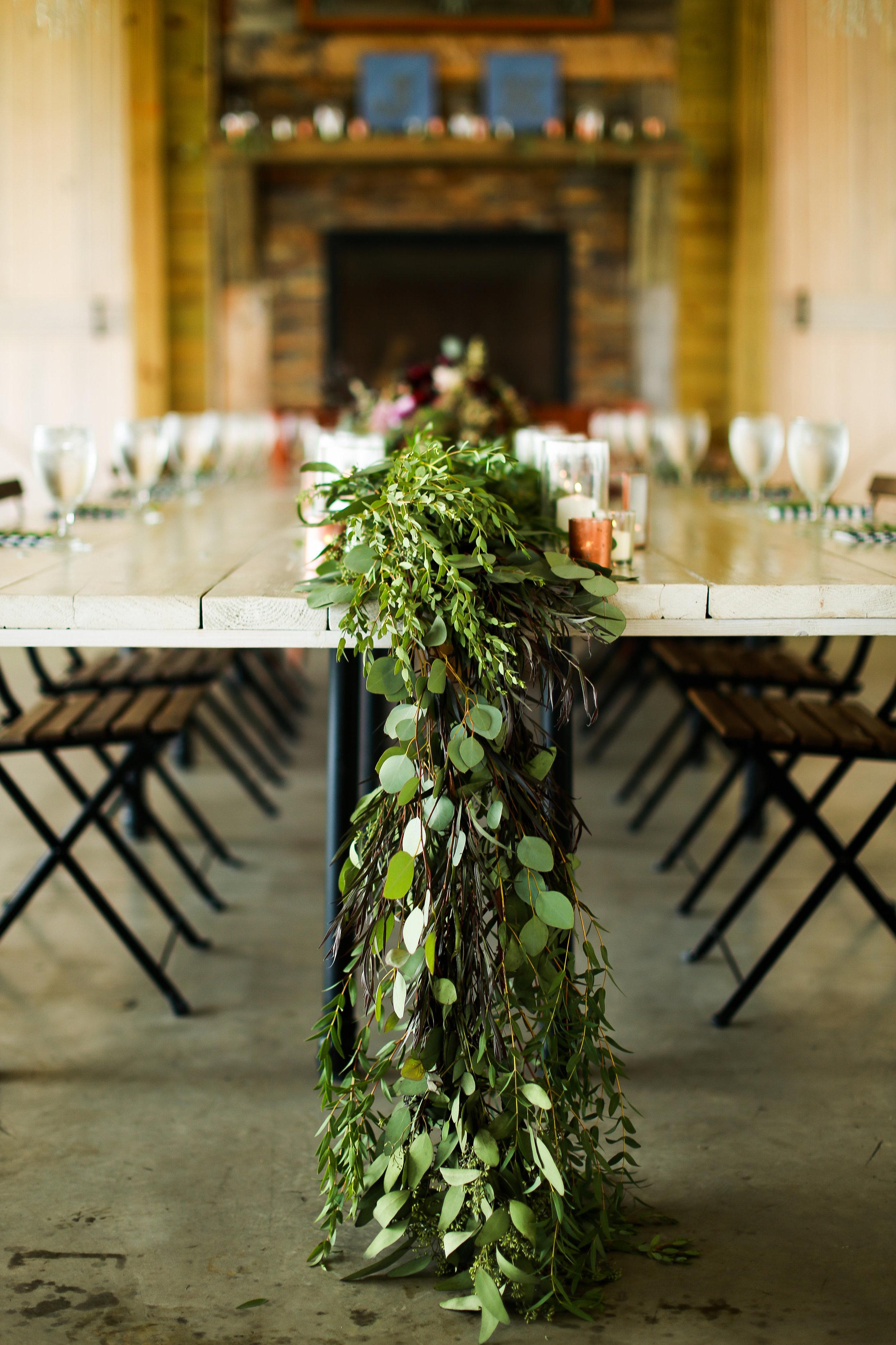 Jenna Kevin Wedding   Sixpence Events day of coordinating   Hannah Schmitt Photography   Legacy Hill Farm   head harvest table with eucalyptus runner