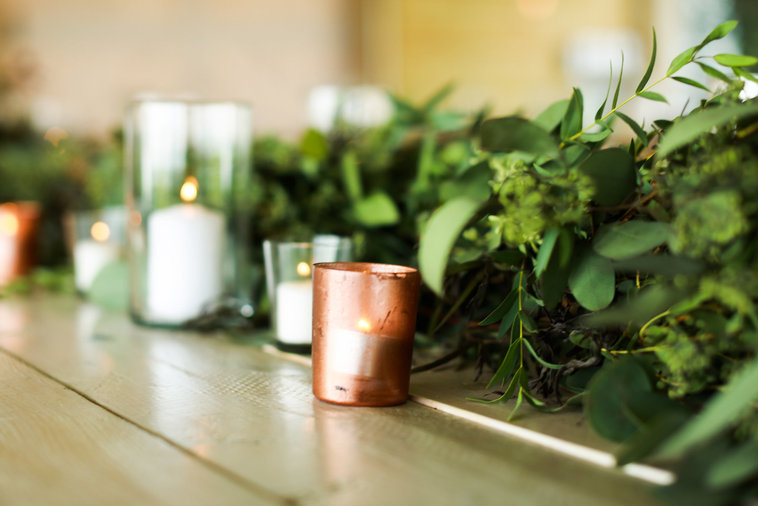 Jenna Kevin Wedding   Sixpence Events day of coordinating   Hannah Schmitt Photography   Legacy Hill Farm   table greenery decor with copper votive and pillar candles