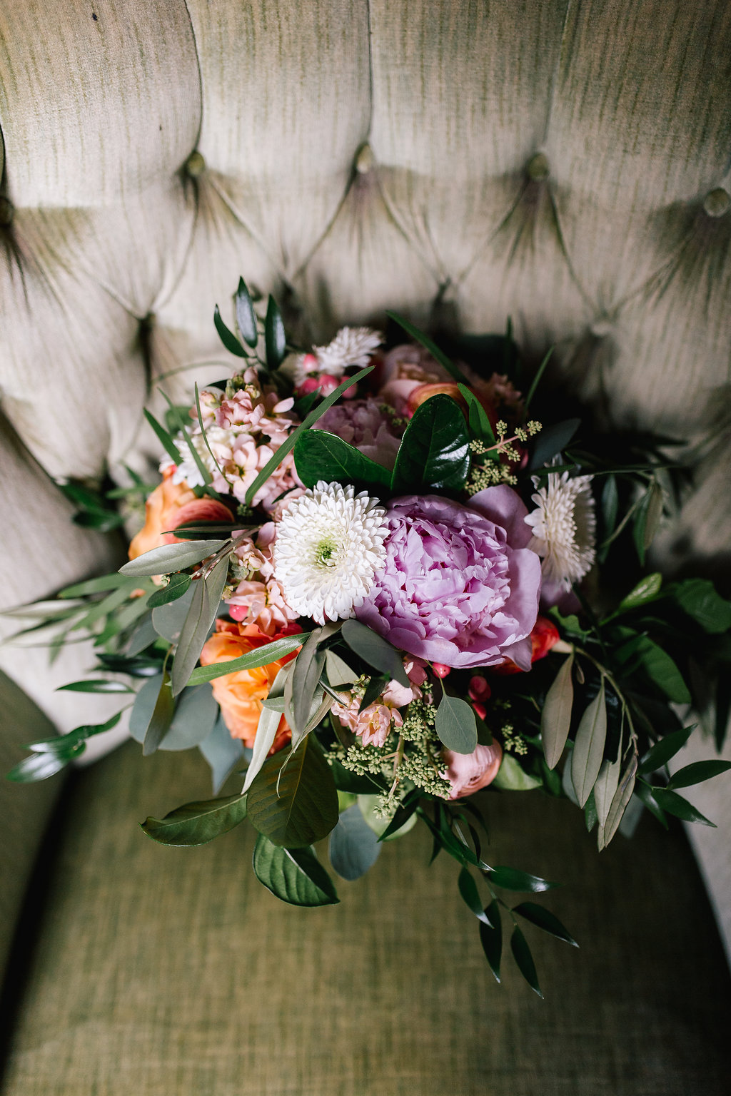 Jade and Seth Bloom Lake Barn wedding | Allison Hopperstad Photography | A Vintage Touch Weddings planning nad design | Day of Coordinating by Sixpence Events | purple peony with pink stock and white mum bridal bouquet