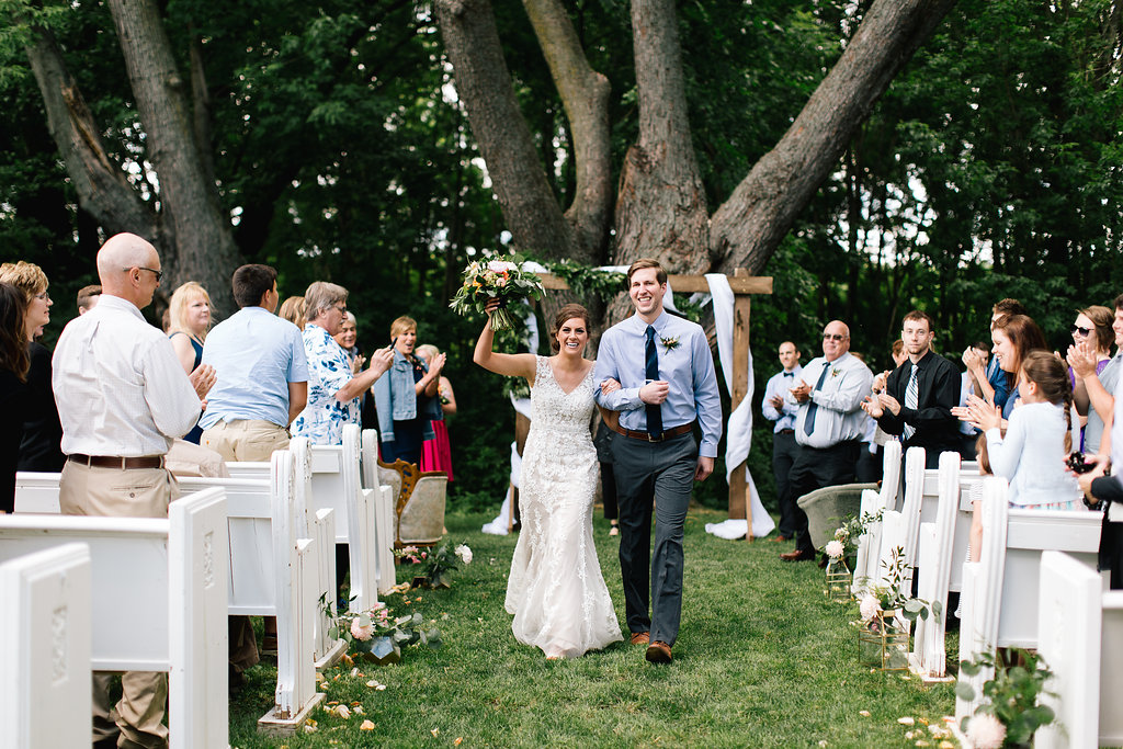 Jade and Seth Bloom Lake Barn wedding | Allison Hopperstad Photography | A Vintage Touch Weddings planning nad design | Day of Coordinating by Sixpence Events | right after the ceremony walking down the aisle