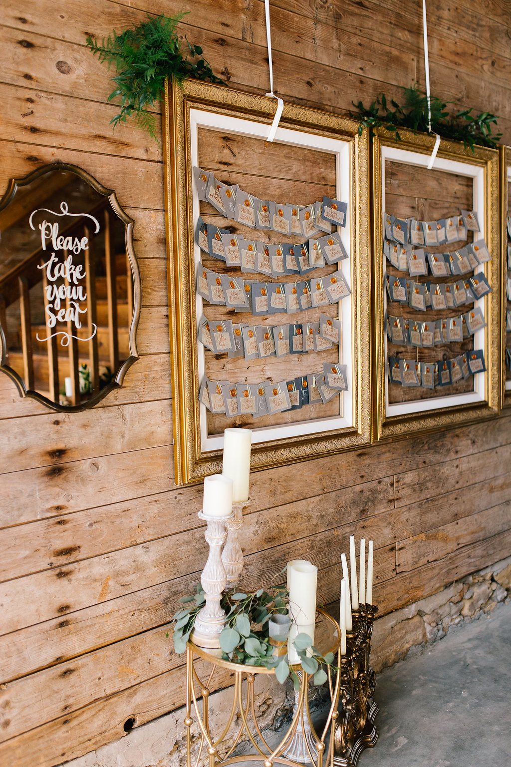 Jade and Seth Bloom Lake Barn wedding | Allison Hopperstad Photography | A Vintage Touch Weddings planning nad design | Day of Coordinating by Sixpence Events | copper and grey place card with wax letter stamp in gold frame with please take a seat mirror sign