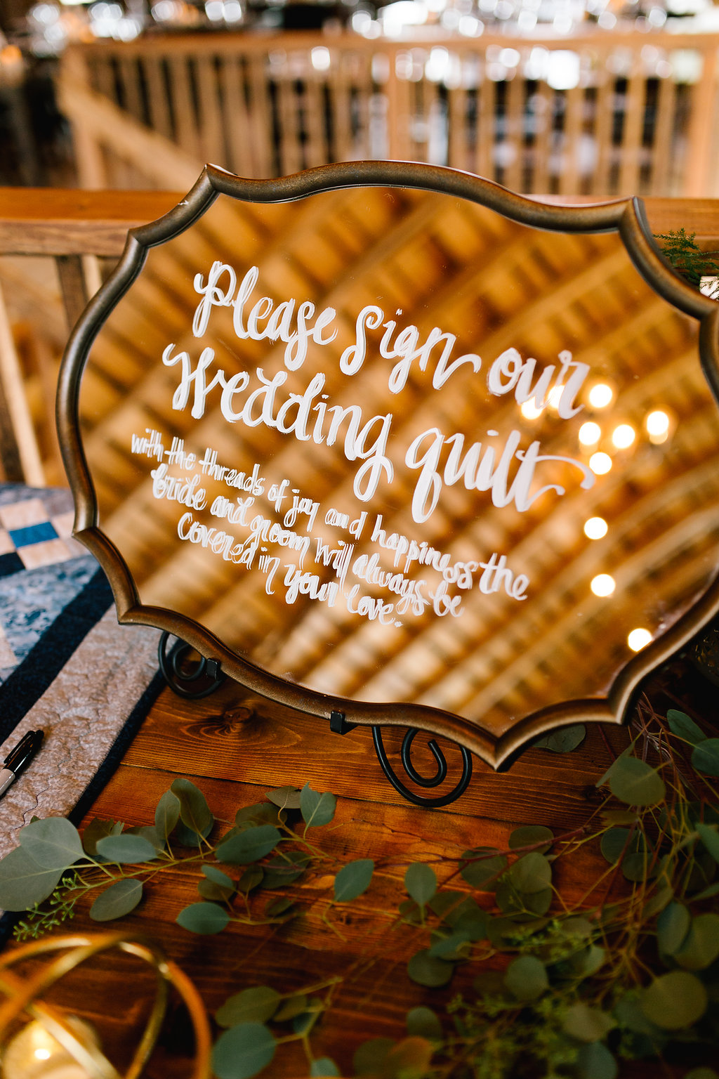 Jade and Seth Bloom Lake Barn wedding | Allison Hopperstad Photography | A Vintage Touch Weddings planning nad design | Day of Coordinating by Sixpence Events | mirror sign for wedding quilt