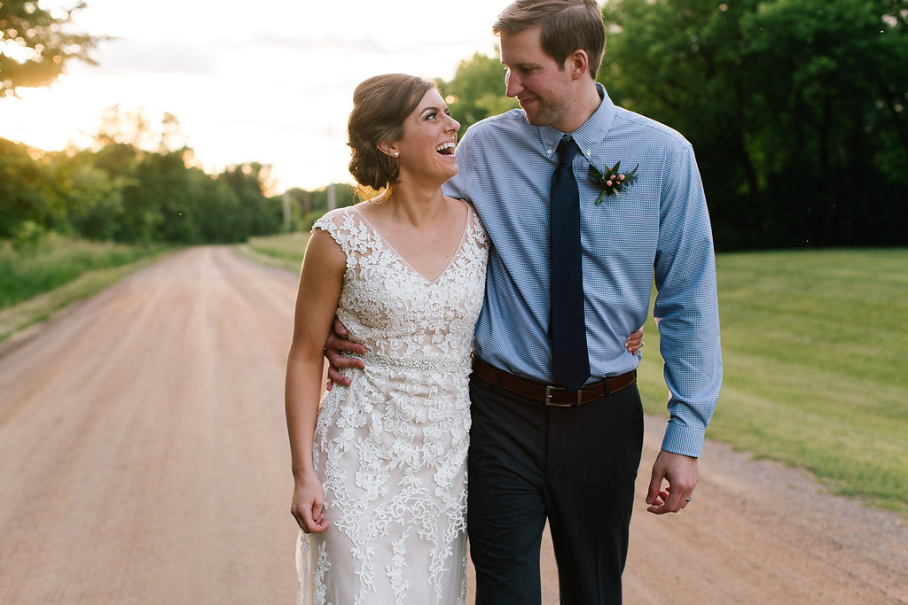 Jade and Seth Bloom Lake Barn wedding | Allison Hopperstad Photography | A Vintage Touch Weddings planning nad design | Day of Coordinating by Sixpence Events | golden hour walk | boutonniere with hypericum berries