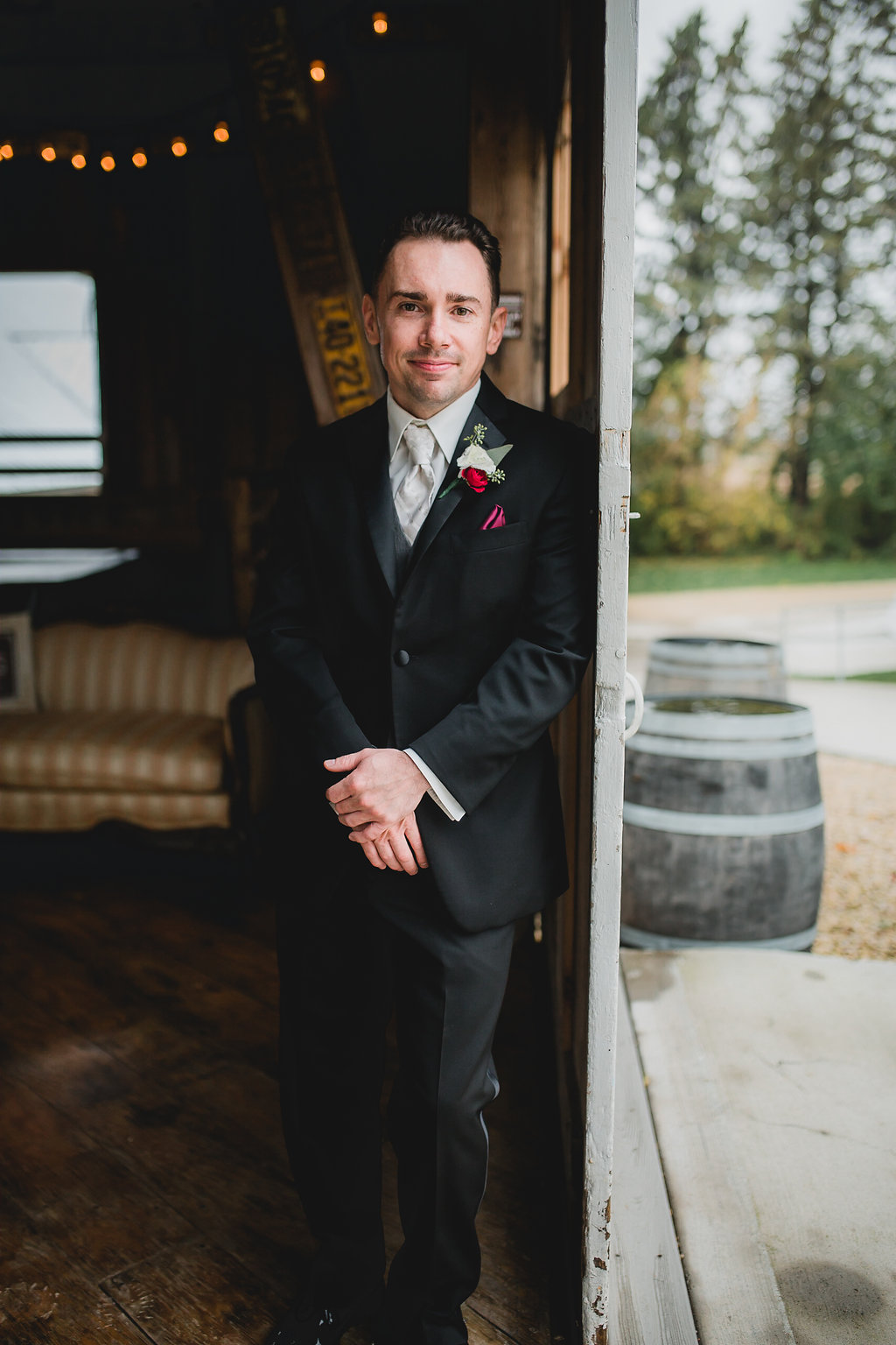 groom waiting by the door | Leslee & Billy | Legacy Hill Farm Wedding | Aqua Fox Photography | A Vintage Touch Wedding Planning | Sixpence Events & Planning day of coordinating | black suit with white on white striped tie, grey vest, and magenta pocket square