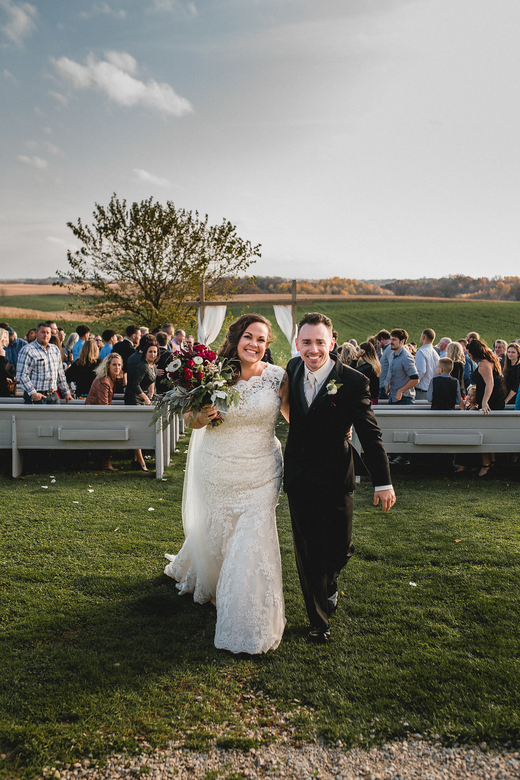Leslee + Billy | Aqua Fox Photography | Legacy Hill Farm | just married photo at the end of the aisle