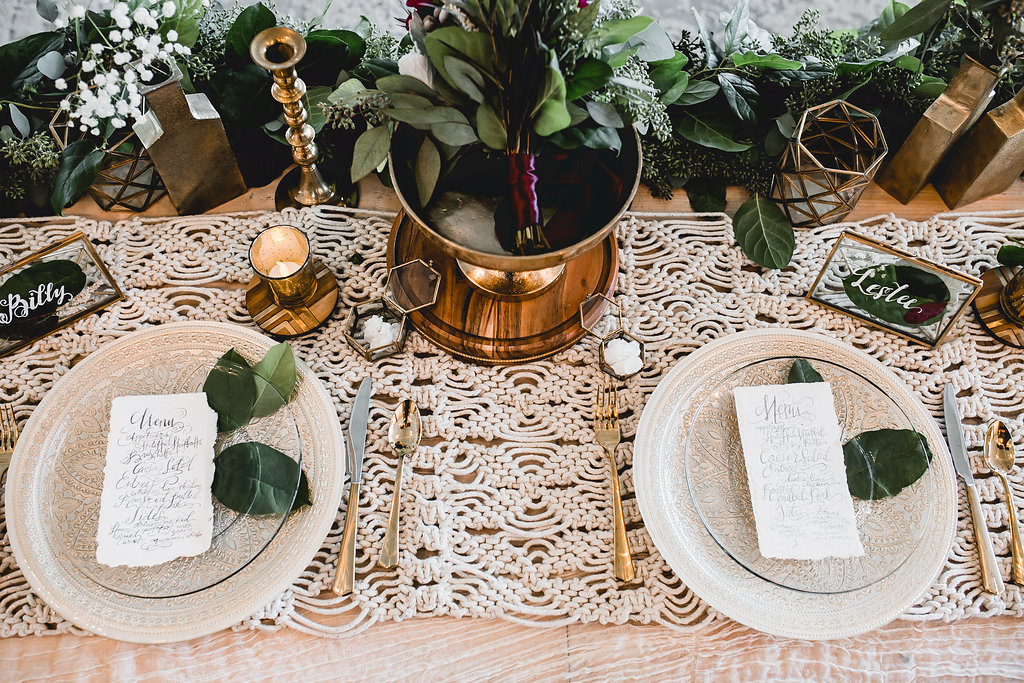 Leslee + Billy | Aqua Fox Photography | Legacy Hill Farm |  head table with macrame designed by A Vintage Touch Weddings and gold flatware with a greenery runner