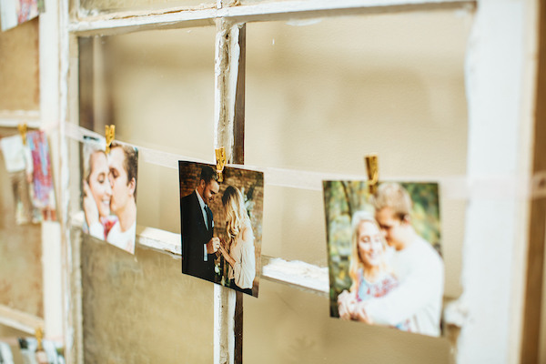 Hailey and Hunter | Alyssa Lee Photography | Sixpence Events & Planning | pictures hanging from old window