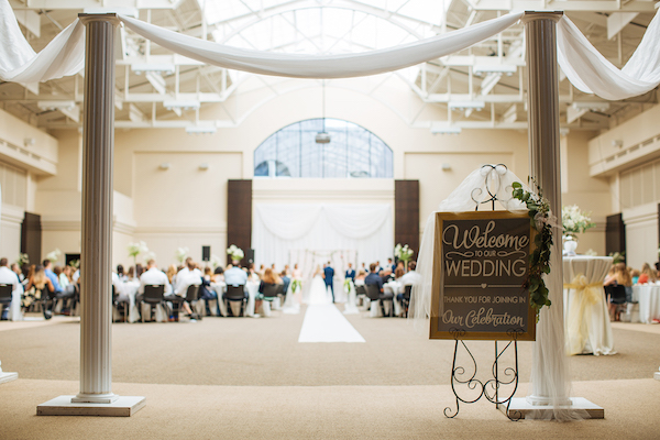 Hailey and Hunter | Alyssa Lee Photography | Sixpence Events & Planning |  welcome sign | pillars with draping