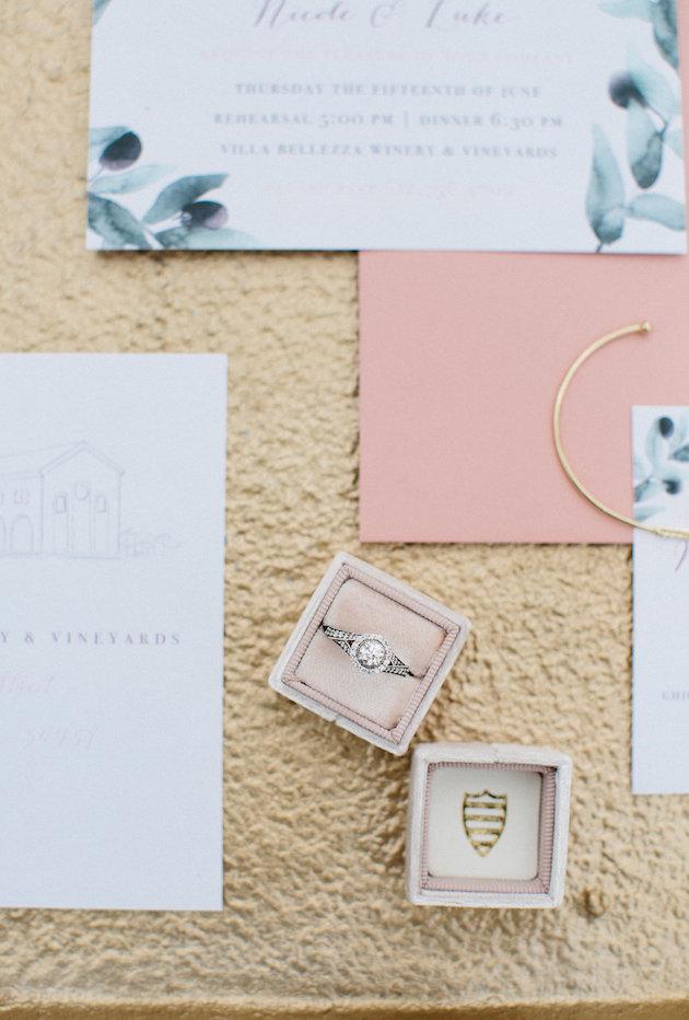 Nicole + Luke | Villa Bellezza | Kristina Lorraine Photo gold tray with wedding stationery details, gold hair band, mrs box, italian coins, envelope liner