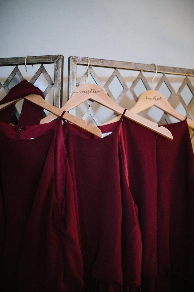 Nicole + Luke | Villa Bellezza | Kristina Lorraine Photo | Bill Levkoff bridesmaid dresses on wood hangers with personalized names