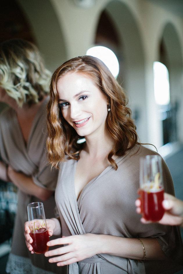 Nicole + Luke | Villa Bellezza | Kristina Lorraine Photo | matching bridesmaids robes with stemless champagne flutes