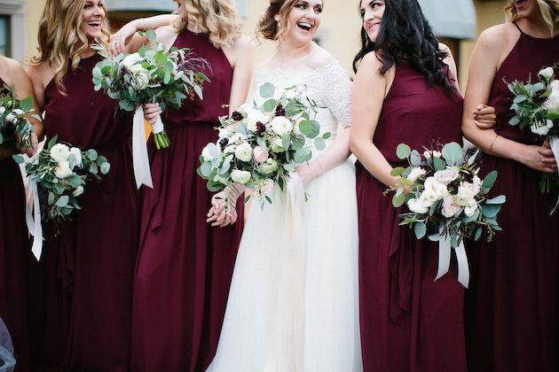 bridesmaids in wine dresses | artemisia flowers with scabiosa and silver dollar eucalyptus | Nicole + Luke | Villa Bellezza | Kristina Lorraine Photo25.jpg