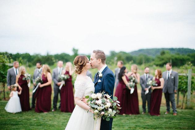bride and groom kiss in front of bridal party | Nicole + Luke | Villa Bellezza | Kristina Lorraine Photo28.jpg