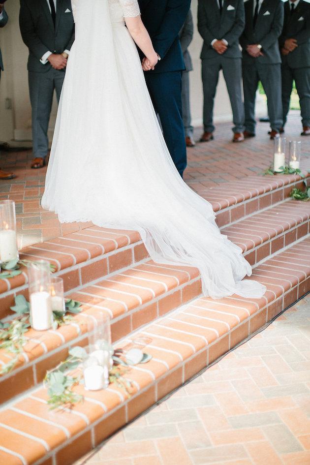 stairs ceremony decor with long train | Nicole + Luke | Villa Bellezza | Kristina Lorraine Photo34.jpg