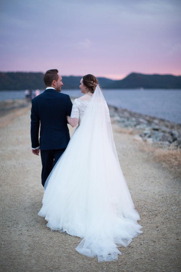 golden hour walk down the sand bar Nicole + Luke | Villa Bellezza | Kristina Lorraine Photo46.jpg