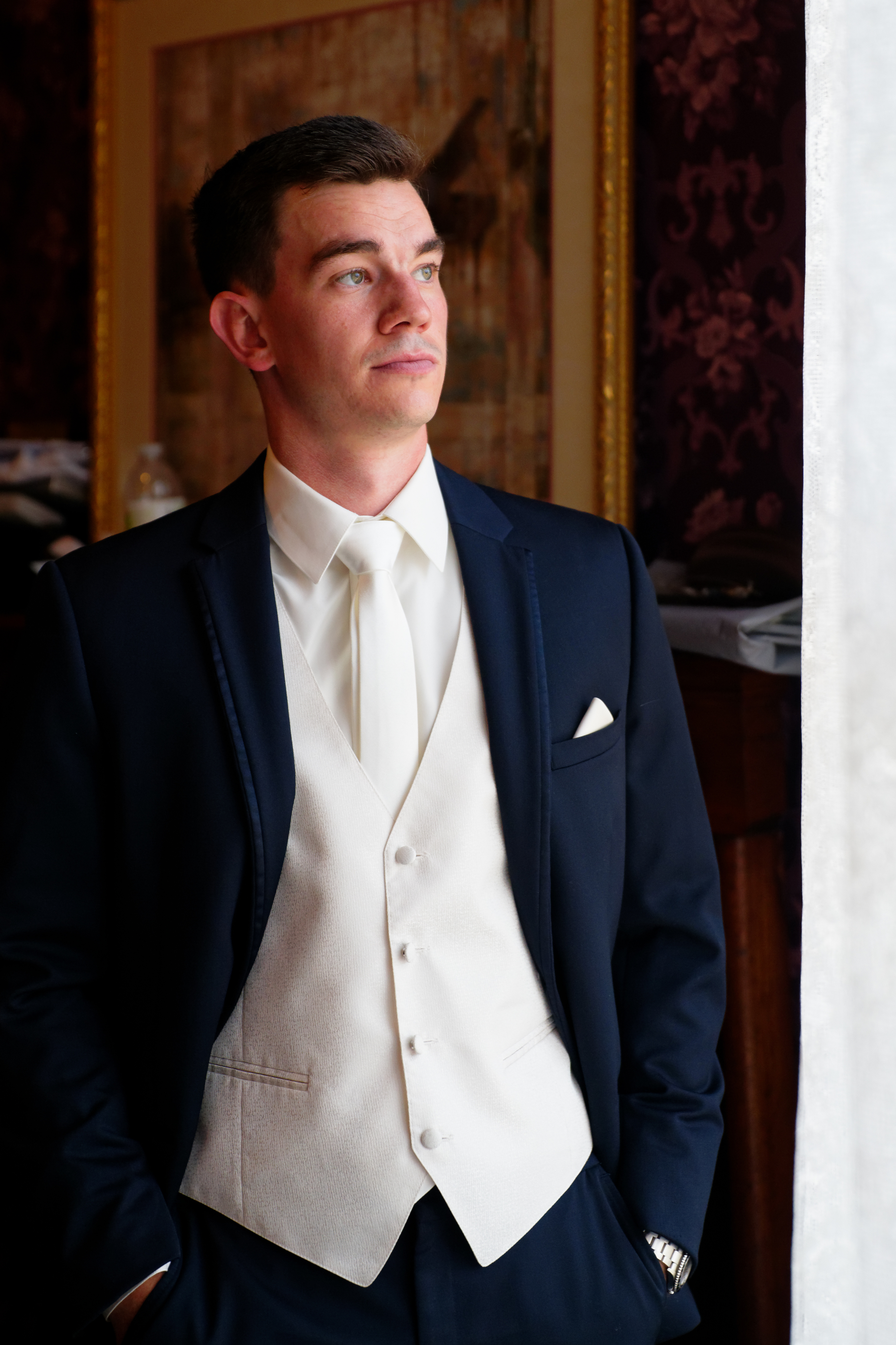 Lauren and Cameron | Historic Concord Exchange | La French Touch Photography | Sixpence Events & Planning day of coordinating | groom portrait | white vest with white shirt and ivory tie, white pocket square and blue suit