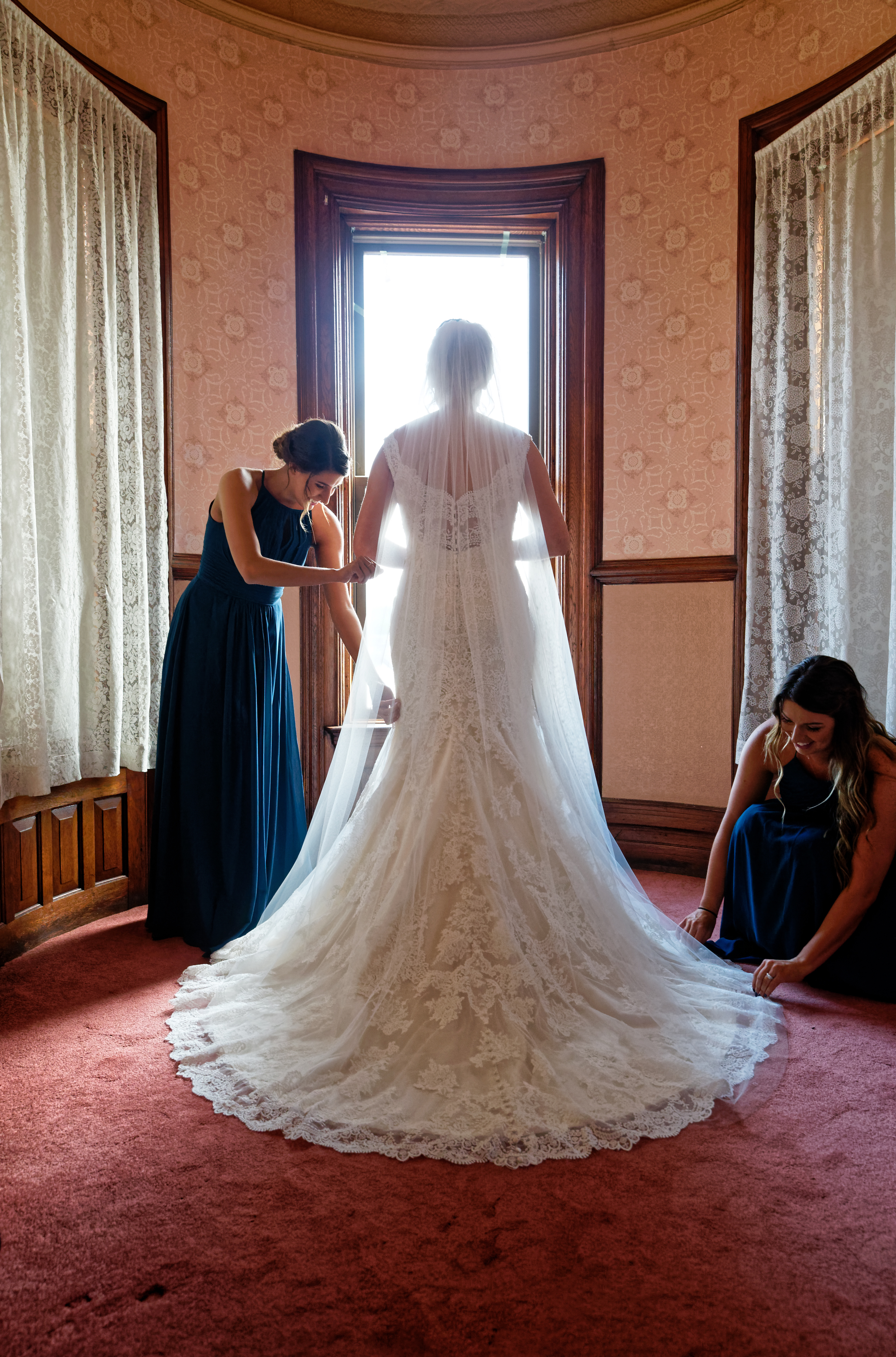 Lauren and Cameron | Historic Concord Exchange | La French Touch Photography | Sixpence Events & Planning day of coordinating | brides sisters helping to fluff her train