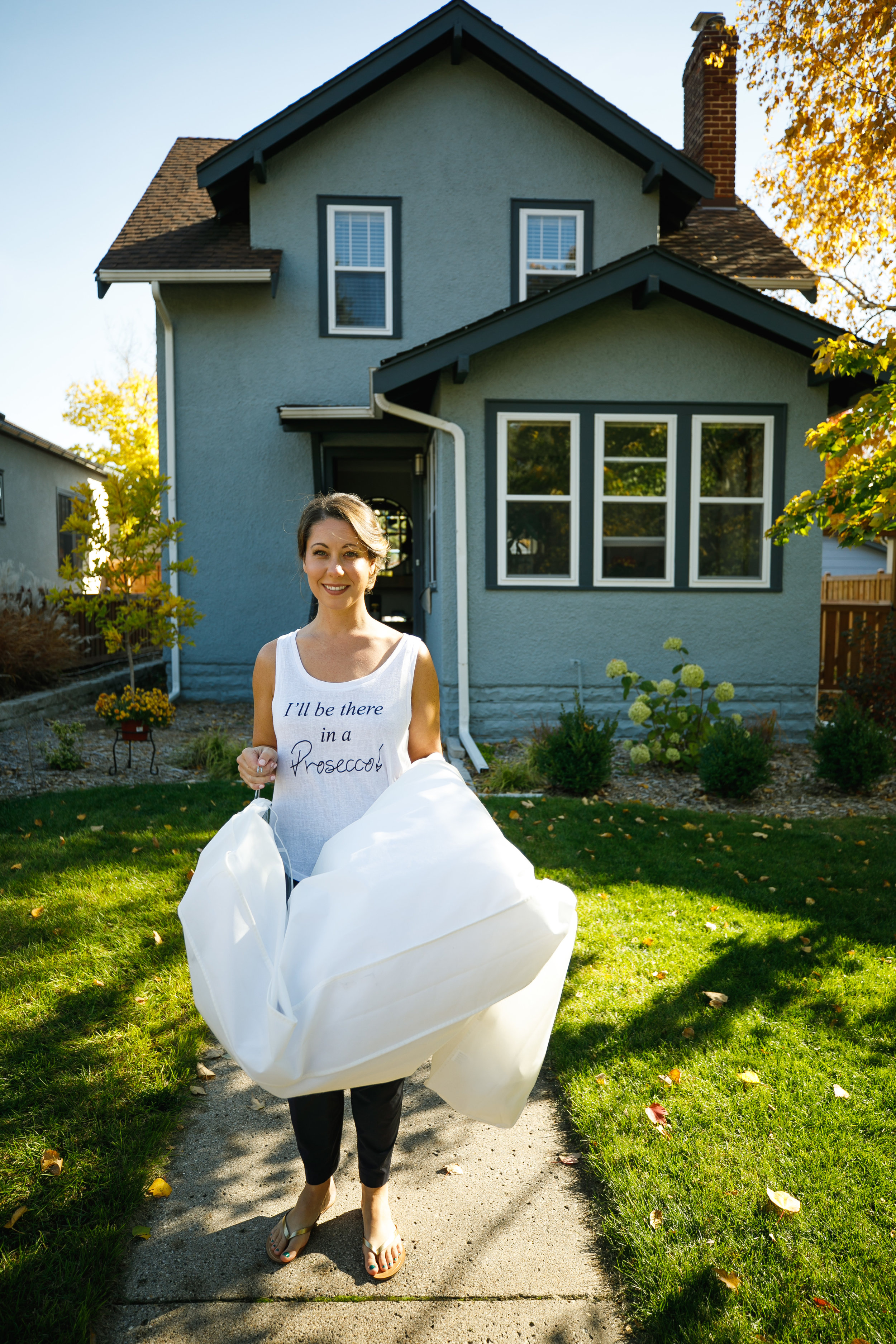 Brovado Wedding Photography | Machine Shop Minneapolis | Sixpence Events Day of Coordinating 6 | bride carrying dress in the morning.jpg