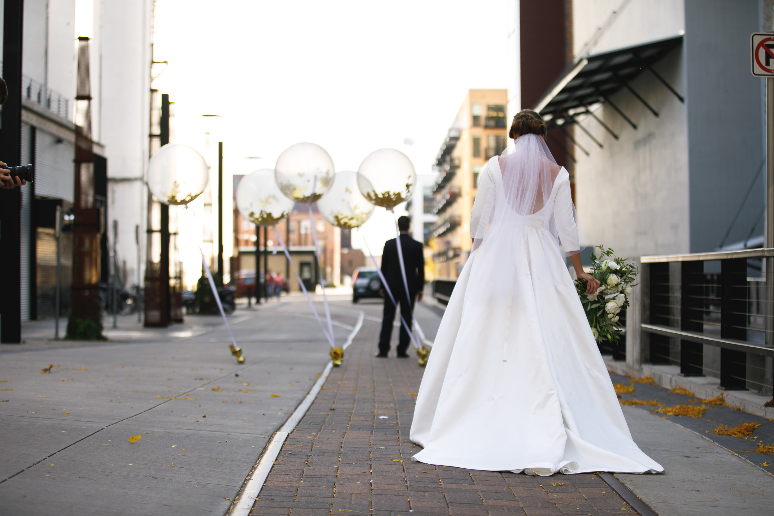 Brovado Wedding Photography | Machine Shop Minneapolis | Sixpence Events Day of Coordinating first look in the alley with balloons.jpg