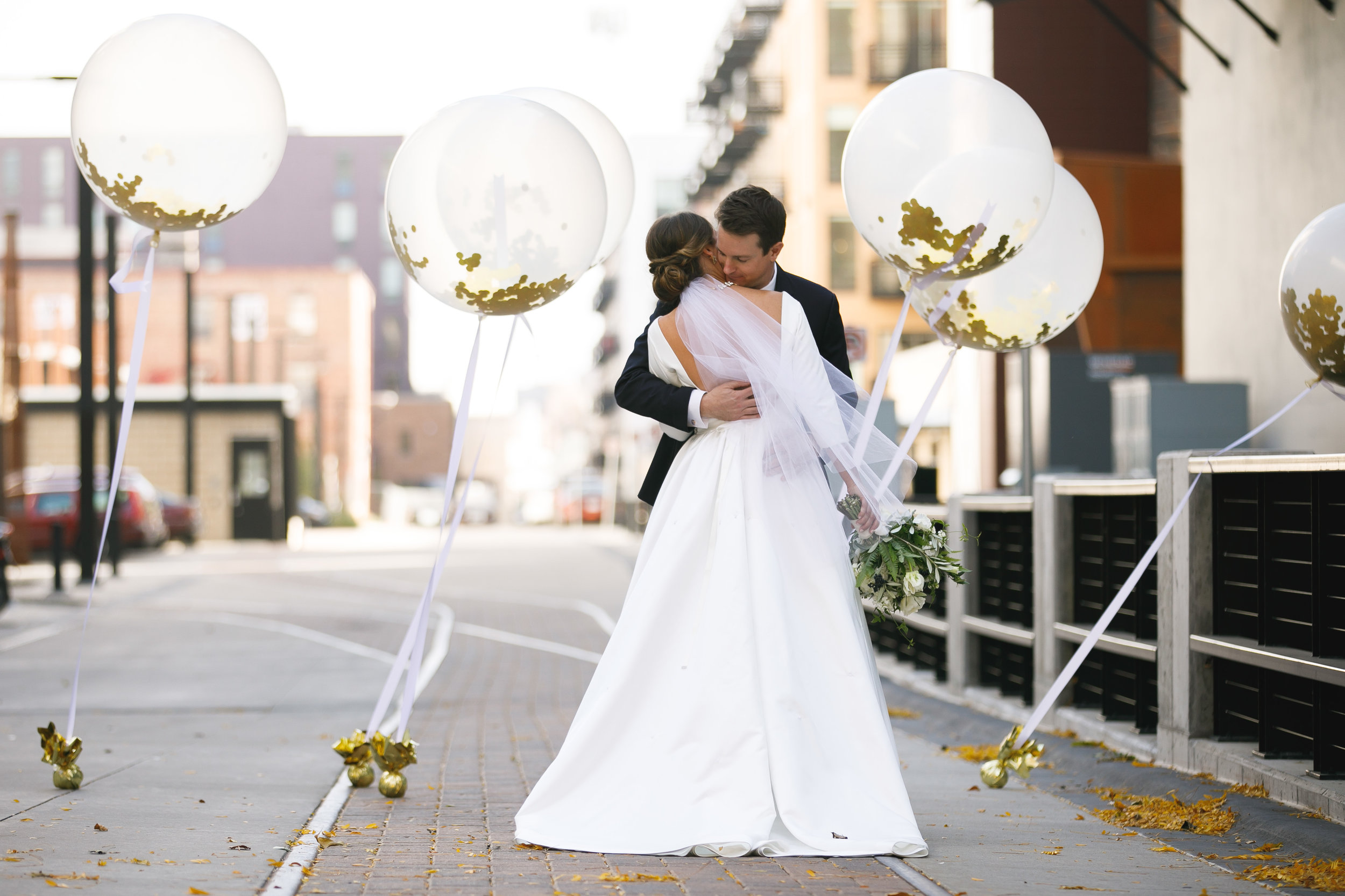 Brovado Wedding Photography | Machine Shop Minneapolis | Sixpence Events Day of Coordinating first look in the alley with balloons bride and groom.jpg