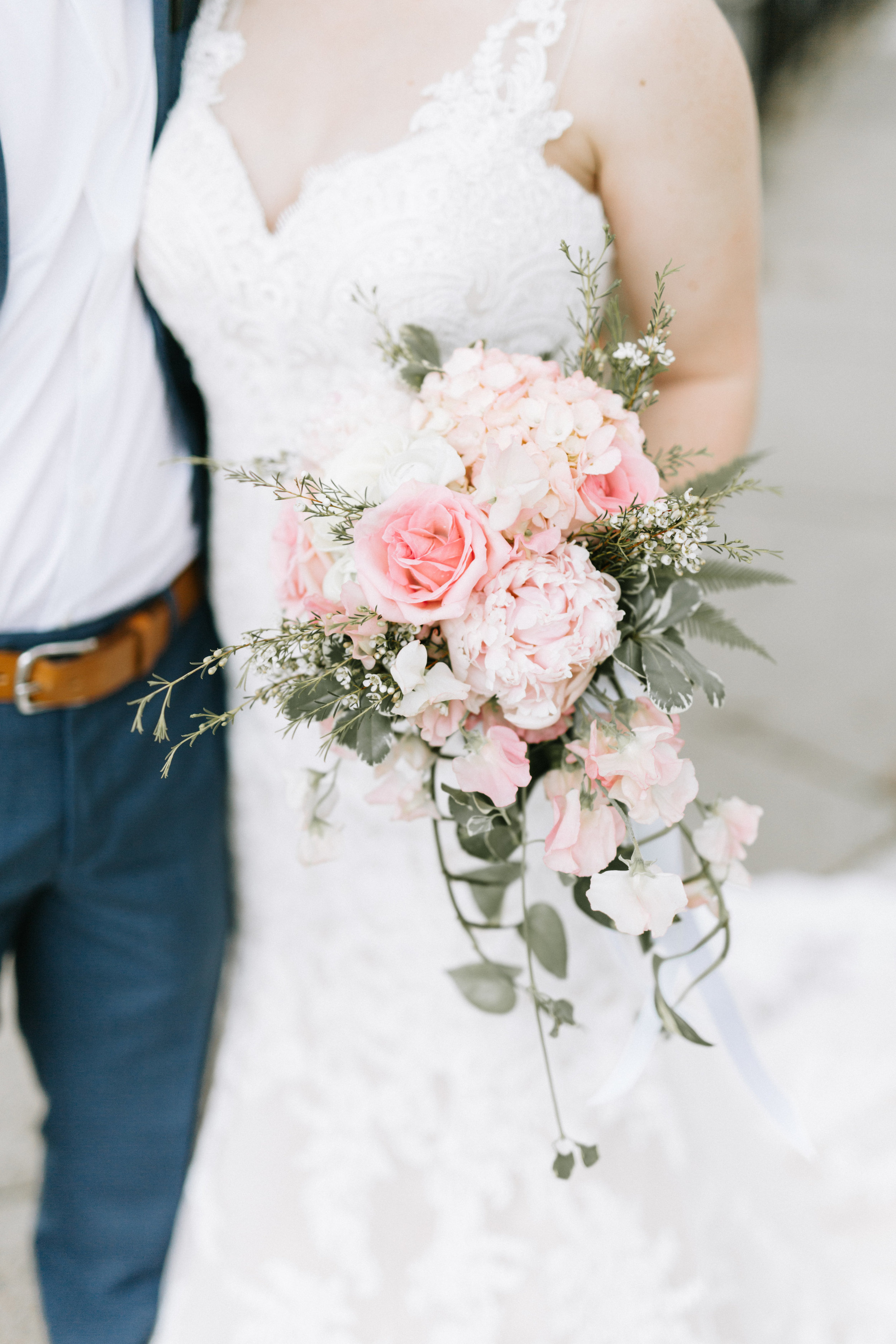 Lydia + Michael Sixpence Events day of coordinating client | Loring Social | Kate Becker Photography | Mann Frau Videography | Minted wedding stationery | bride wit h sweetheart lace neckline sheer straps | groom in true blue suit with tan belt