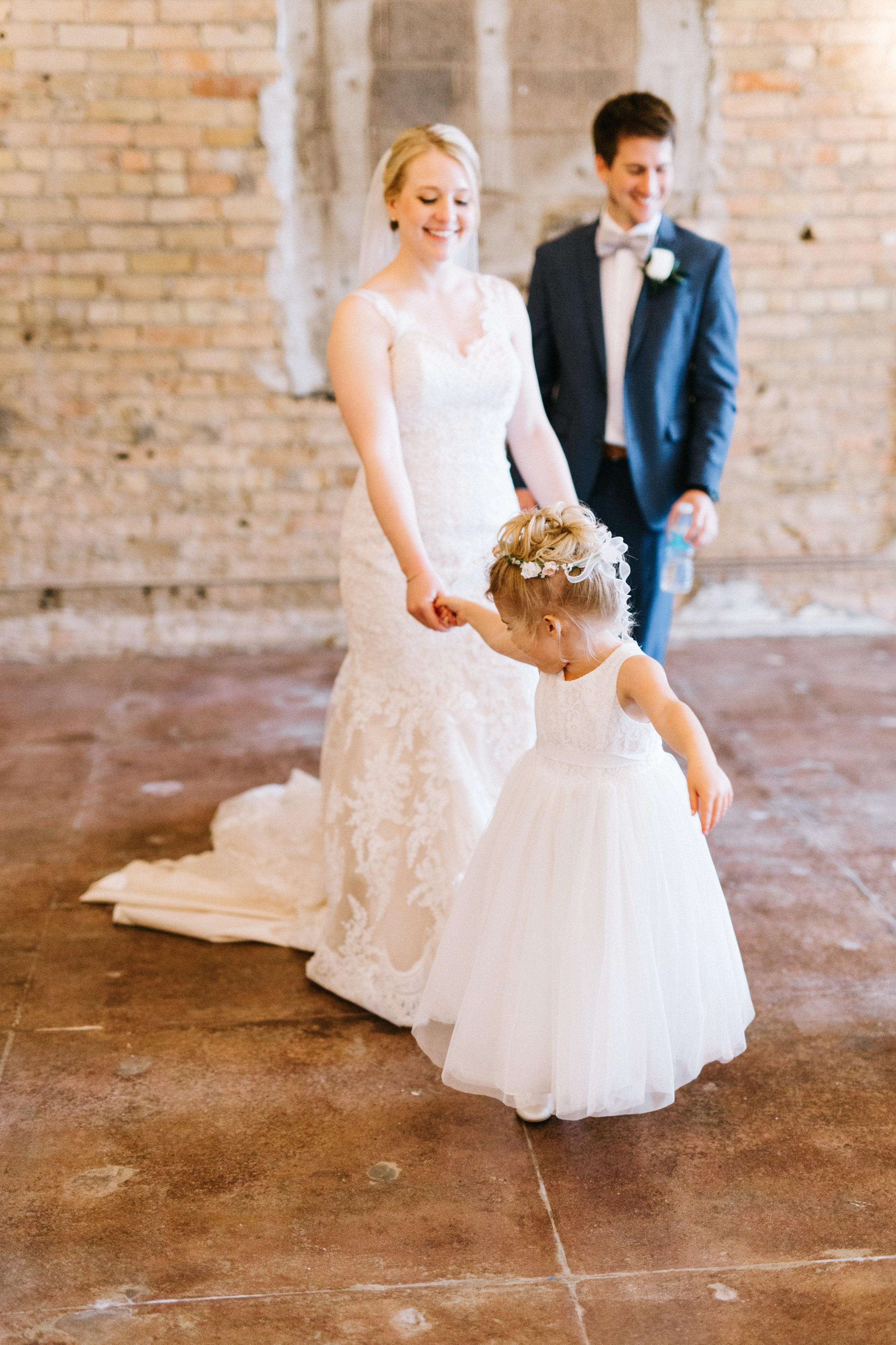 Lydia + Michael Sixpence Events day of coordinating client | Loring Social | Kate Becker Photography | Mann Frau Videography | Minted wedding stationery | flower girl fun with bride | industrial wedding venue with exposed brick and concrete floor