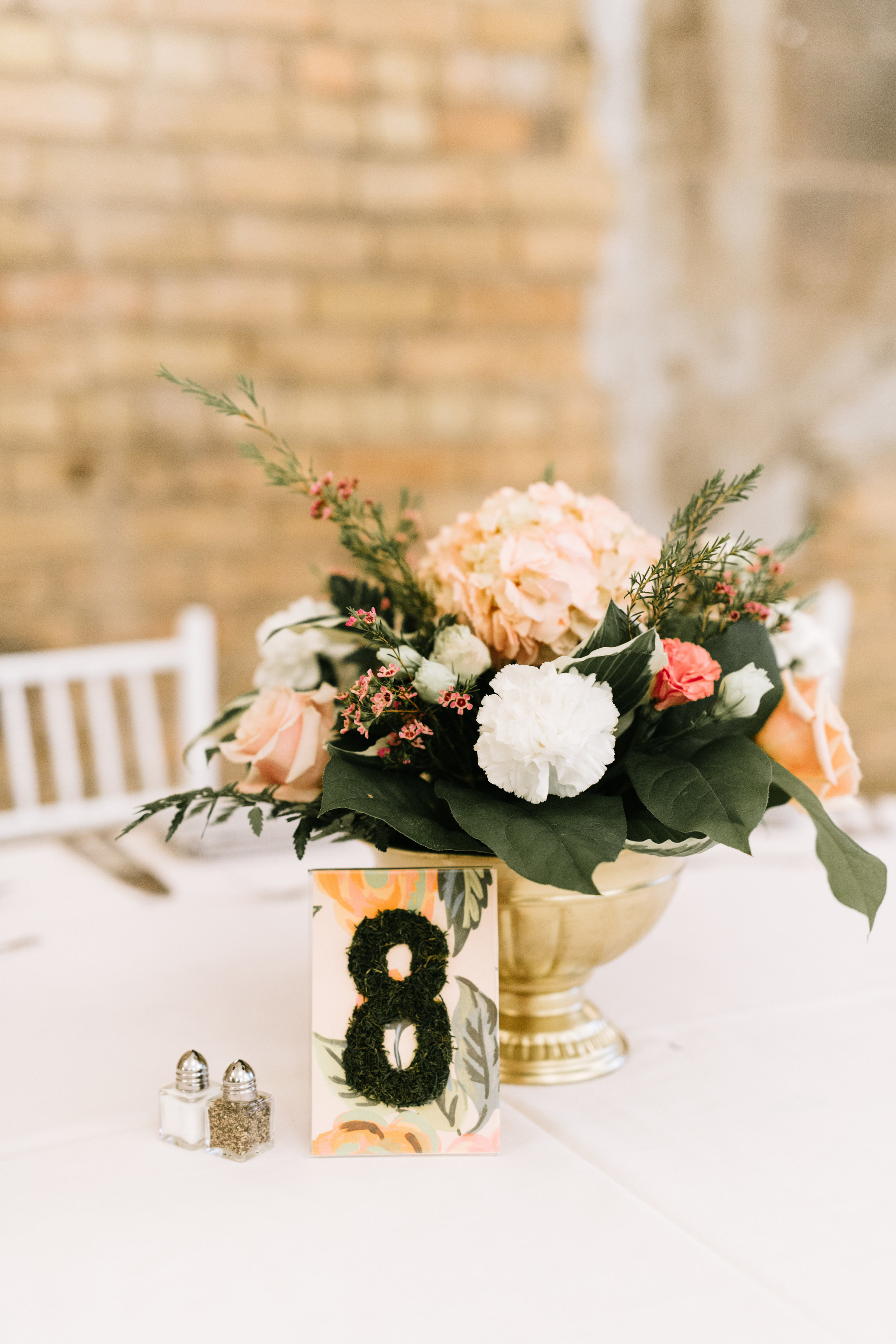 Lydia + Michael Sixpence Events day of coordinating client | Loring Social | Kate Becker Photography | Mann Frau Videography | Minted wedding stationery | moss table number with flower arrangement in gold compote bowl