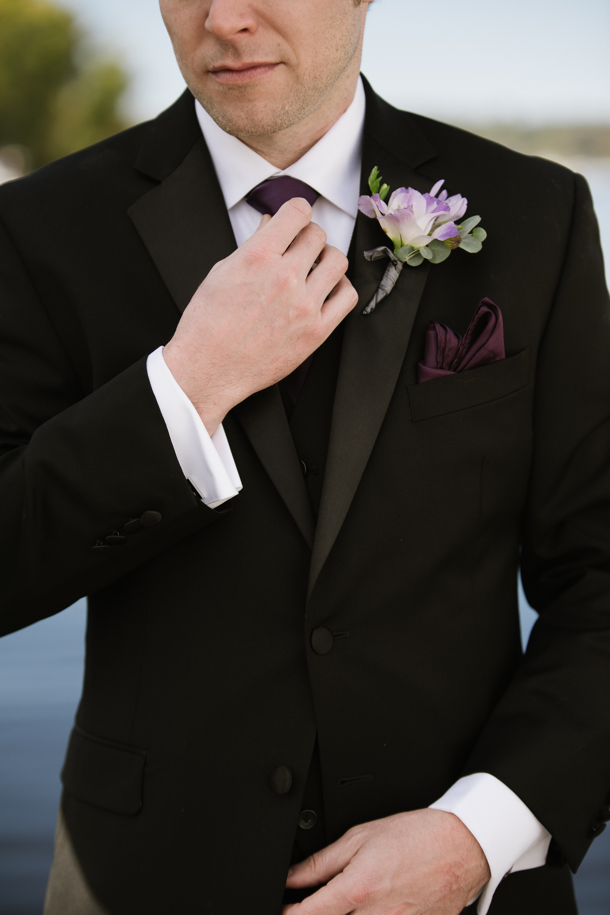 groom with purple boutonniere and black suit with eggplant tie   Dillinger Studios Minneapolis Photographer   Mexican American fusion wedding   Sixpence Events & Planning Minnesota wedding planner .jpg