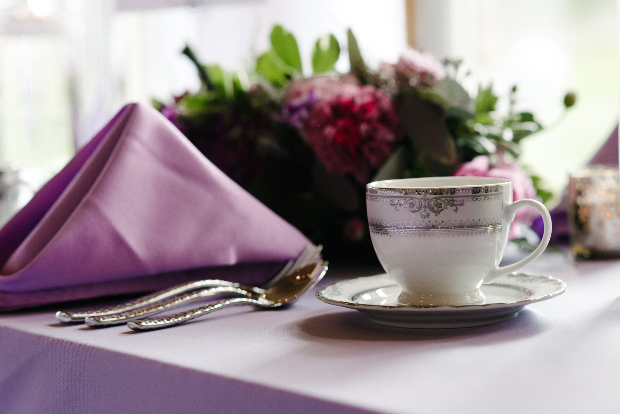 vintage wedding coffee tea cups with matching saucer   lavender napkins and table linen   Dillinger Studios Minneapolis Photographer   Mexican American fusion wedding   Sixpence Events & Planning Minnesota wedding planner .jpg