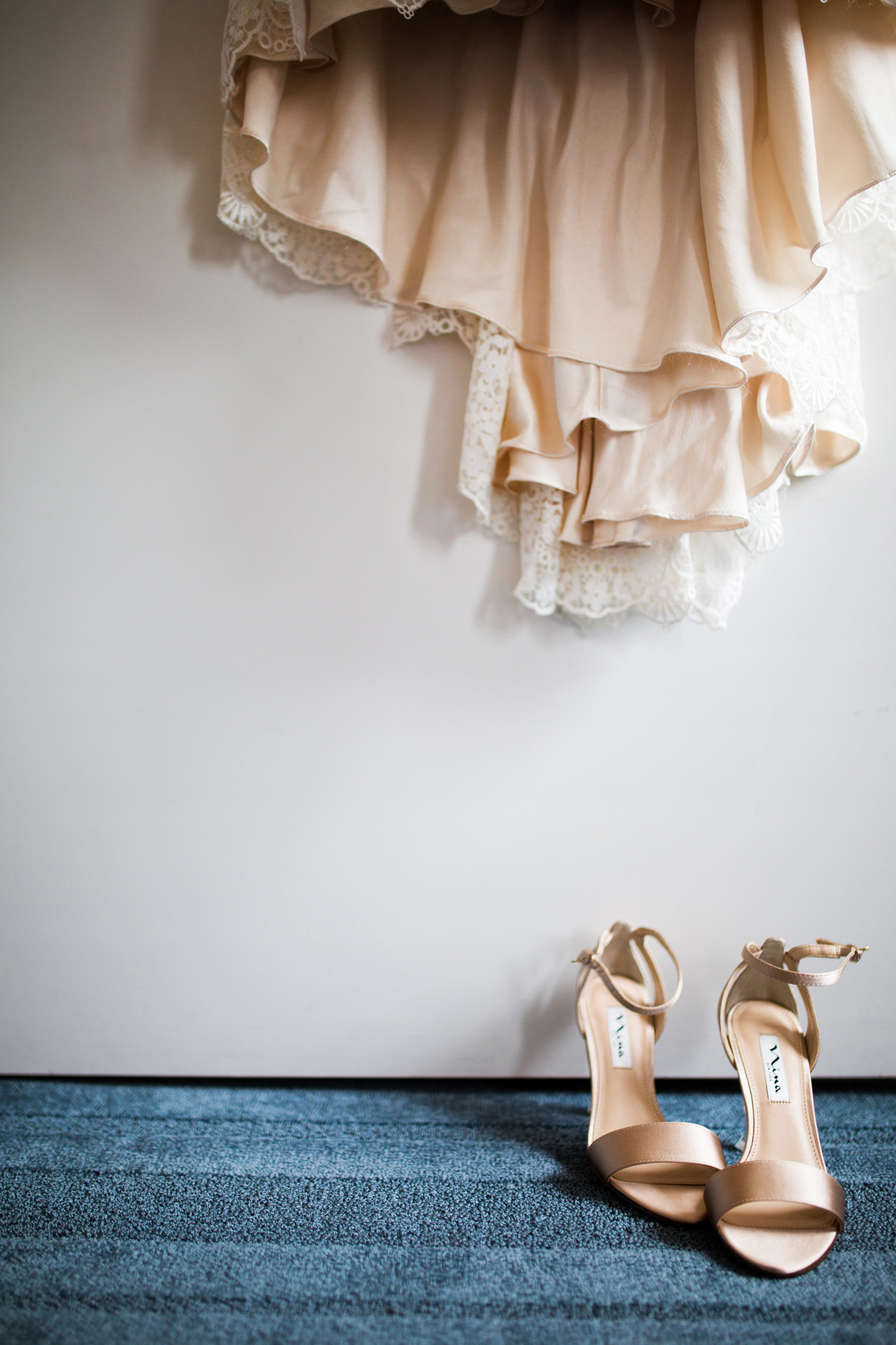 Kaylie + Travis | Sixpence Events wedding planner in the midwest | Studio KH photography | dress and shoes detail shot at the hotel