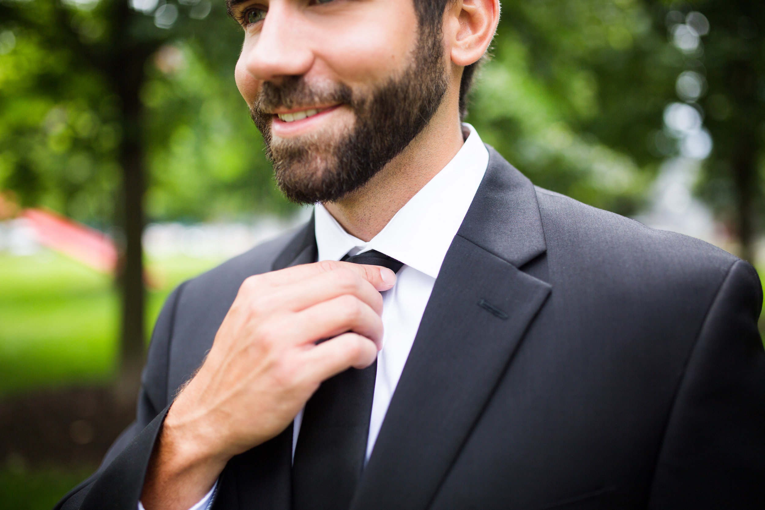 Kaylie + Travis | Sixpence Events wedding planner in the midwest | Studio KH photography | groom waiting for first look close up | groom in black suit with black tie and beard