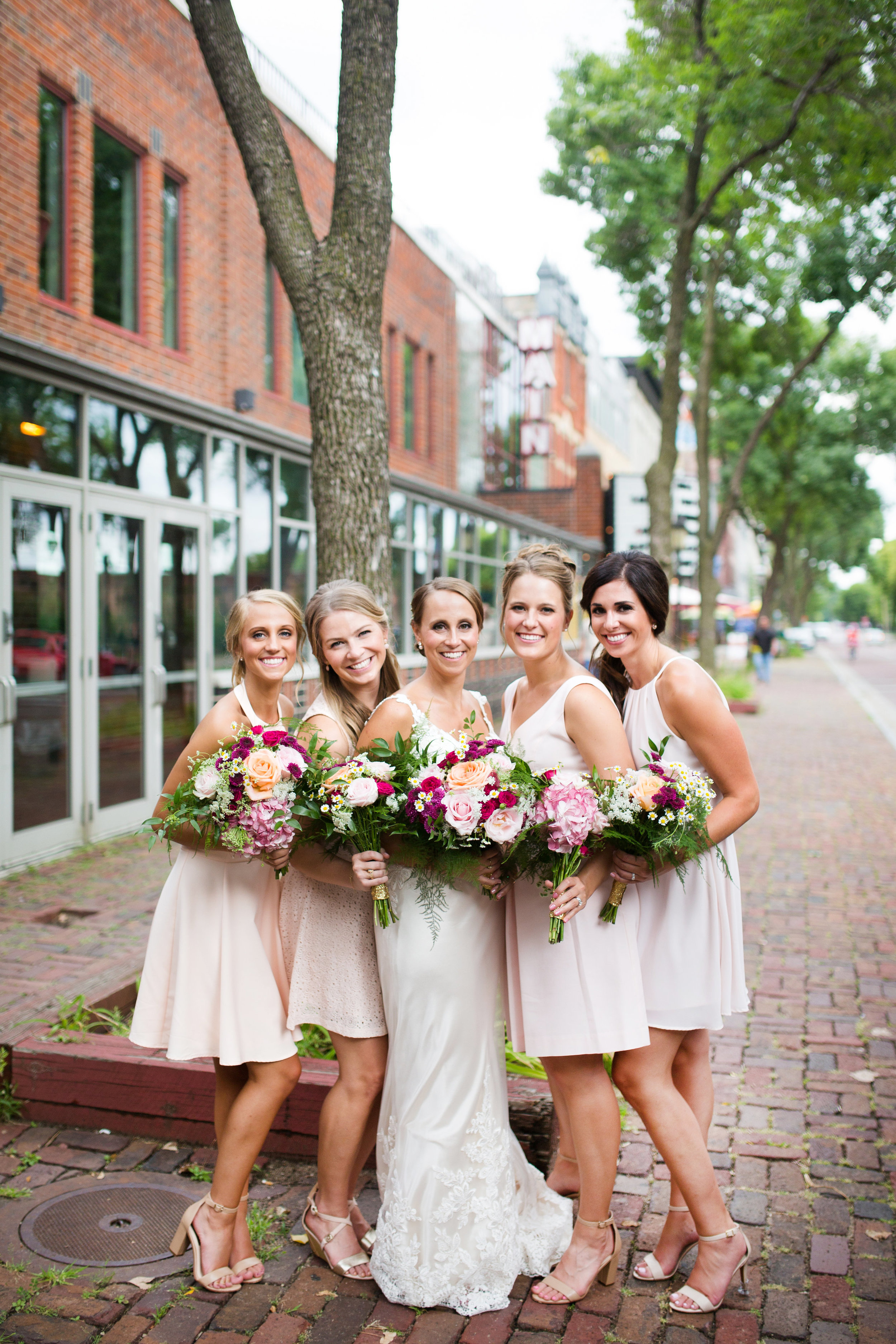 Kaylie + Travis | Sixpence Events wedding planner in the midwest | Studio KH photography | bridesmaids in blush mismatching dresses | St. Anthony Main