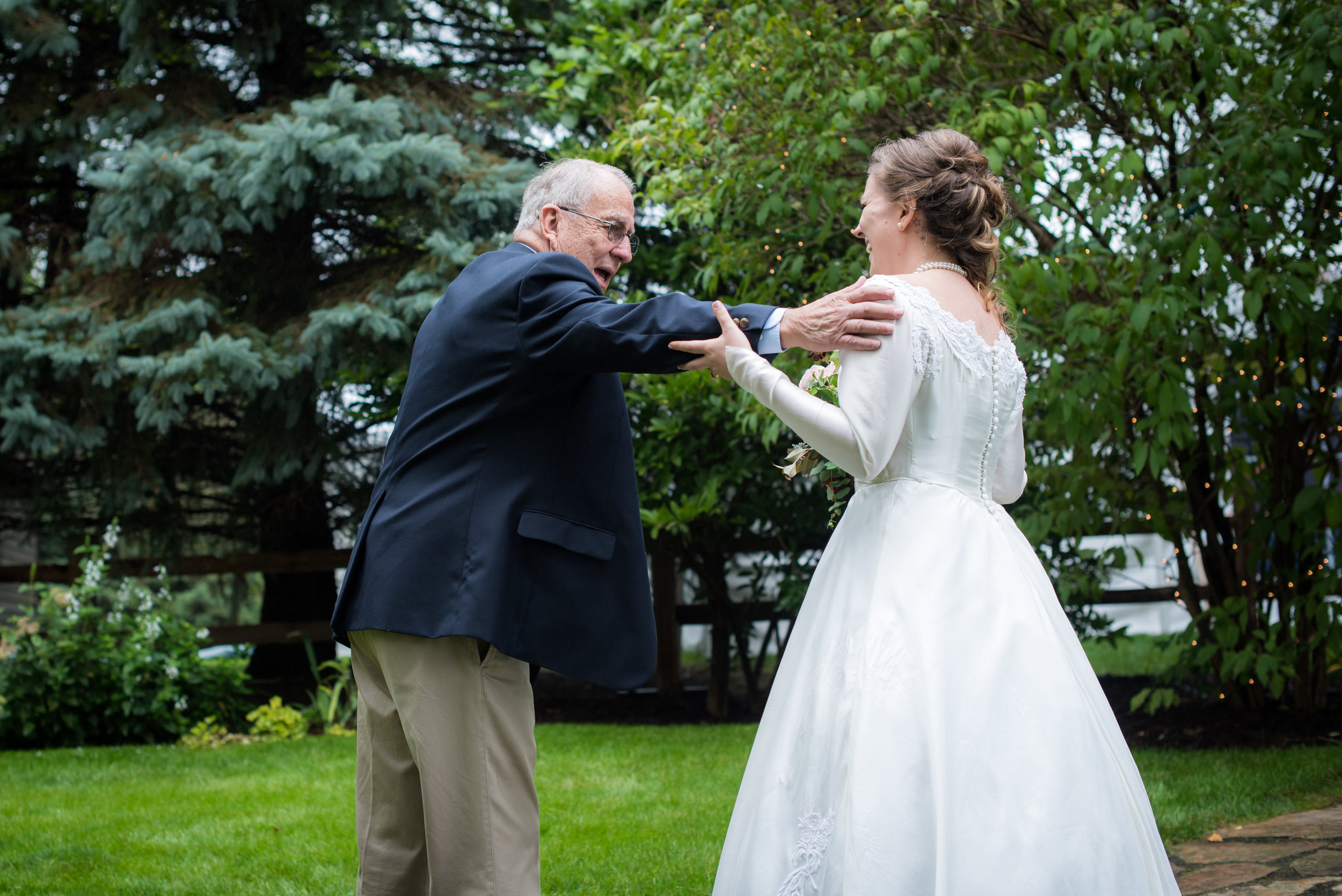grandpa sees granddaughter in his wife's wedding dress // Backyard Wedding in Northfield, MN :: Elliot Malcom Photography :: Megan + Andrew :: Apres Tent Rental :: GastroTruck Catering :: Sixpence Events & Planning .jpg