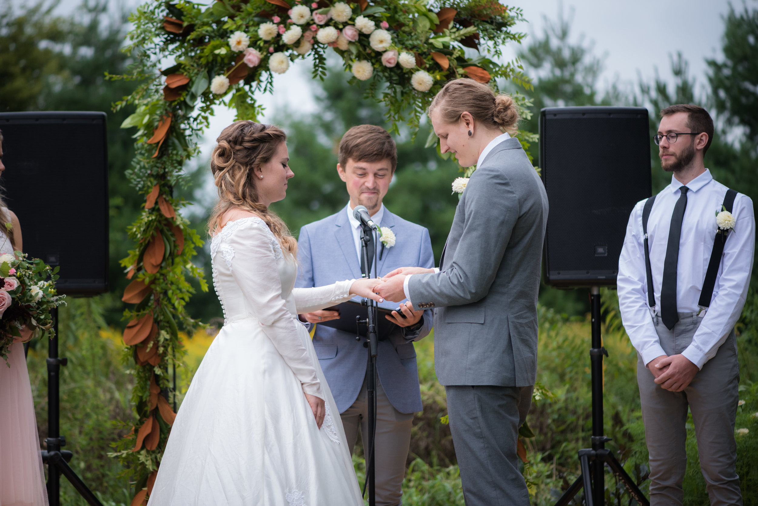 ring exchange ceremony // Backyard Wedding in Northfield, MN :: Elliot Malcom Photography :: Megan + Andrew :: Apres Tent Rental :: GastroTruck Catering :: Sixpence Events & Planning .jpg