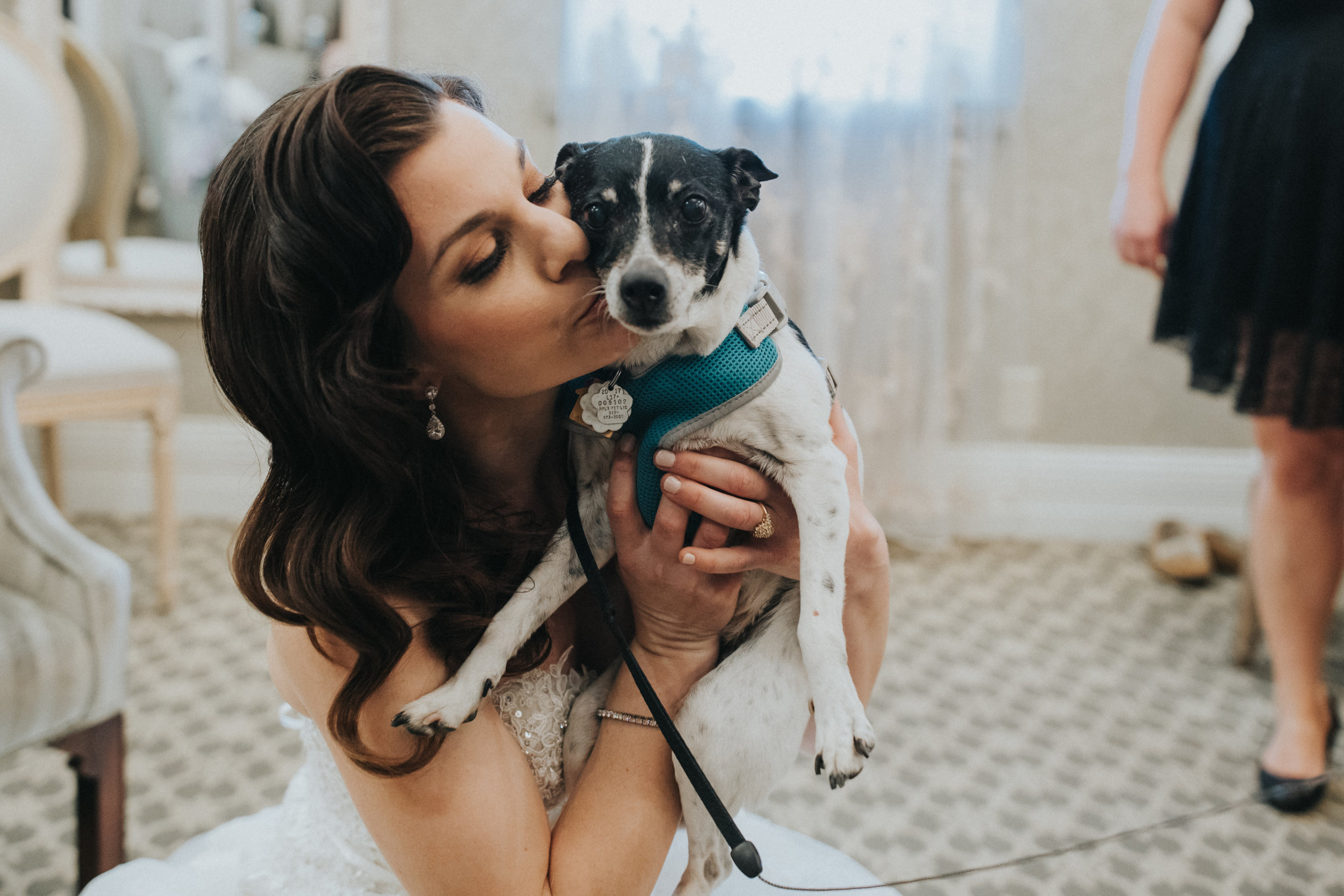 fur baby wedding photo | puppy kiss | Russell Heeter Photography :: Minneapolis wedding planner Sixpence Events :: Nicollet Island Pavilion :: april wedding in Minnesota.jpg