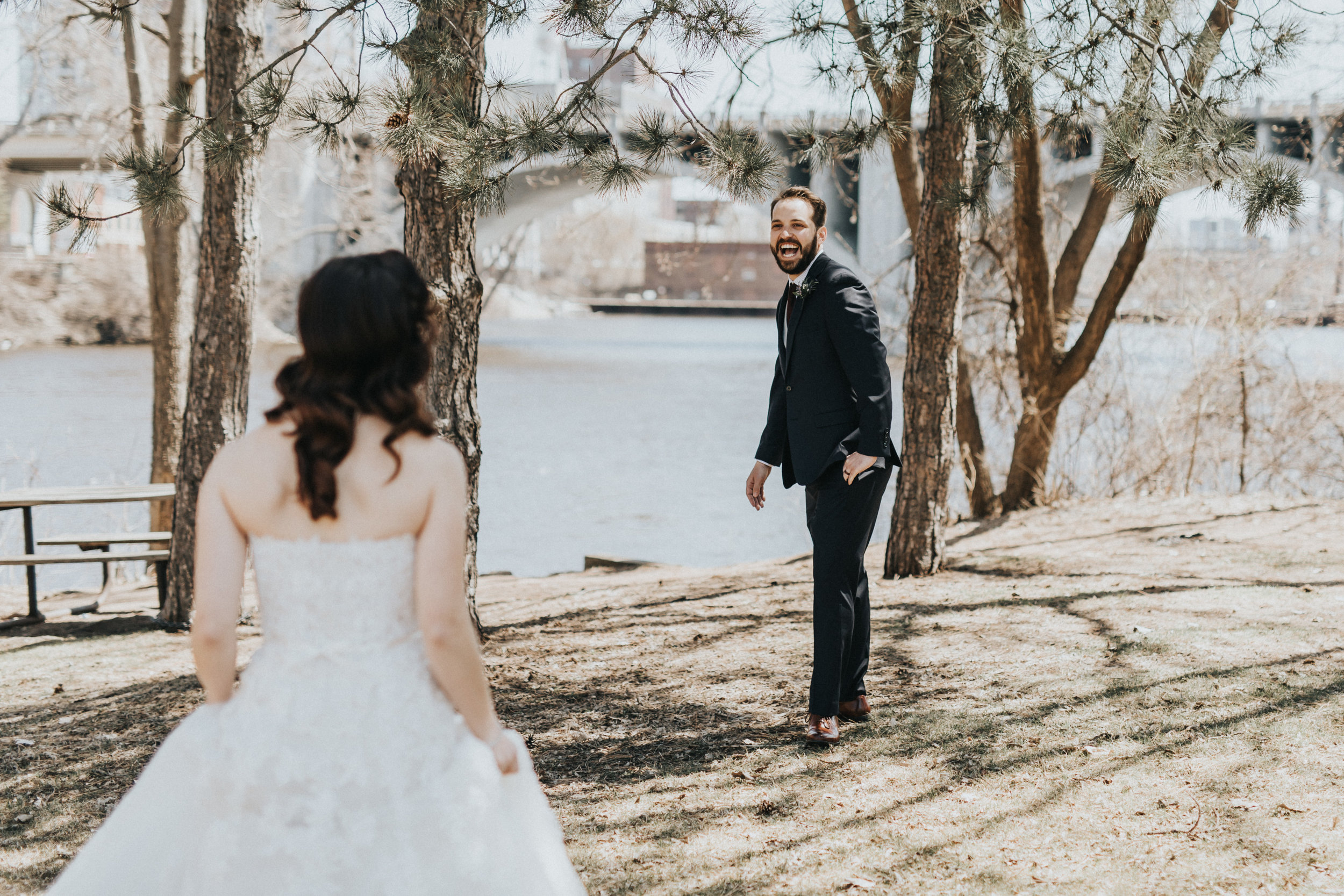 first look groom ecstatic | Russell Heeter Photography :: Minneapolis wedding planner Sixpence Events :: Nicollet Island Pavilion :: april wedding in Minnesota.jpg