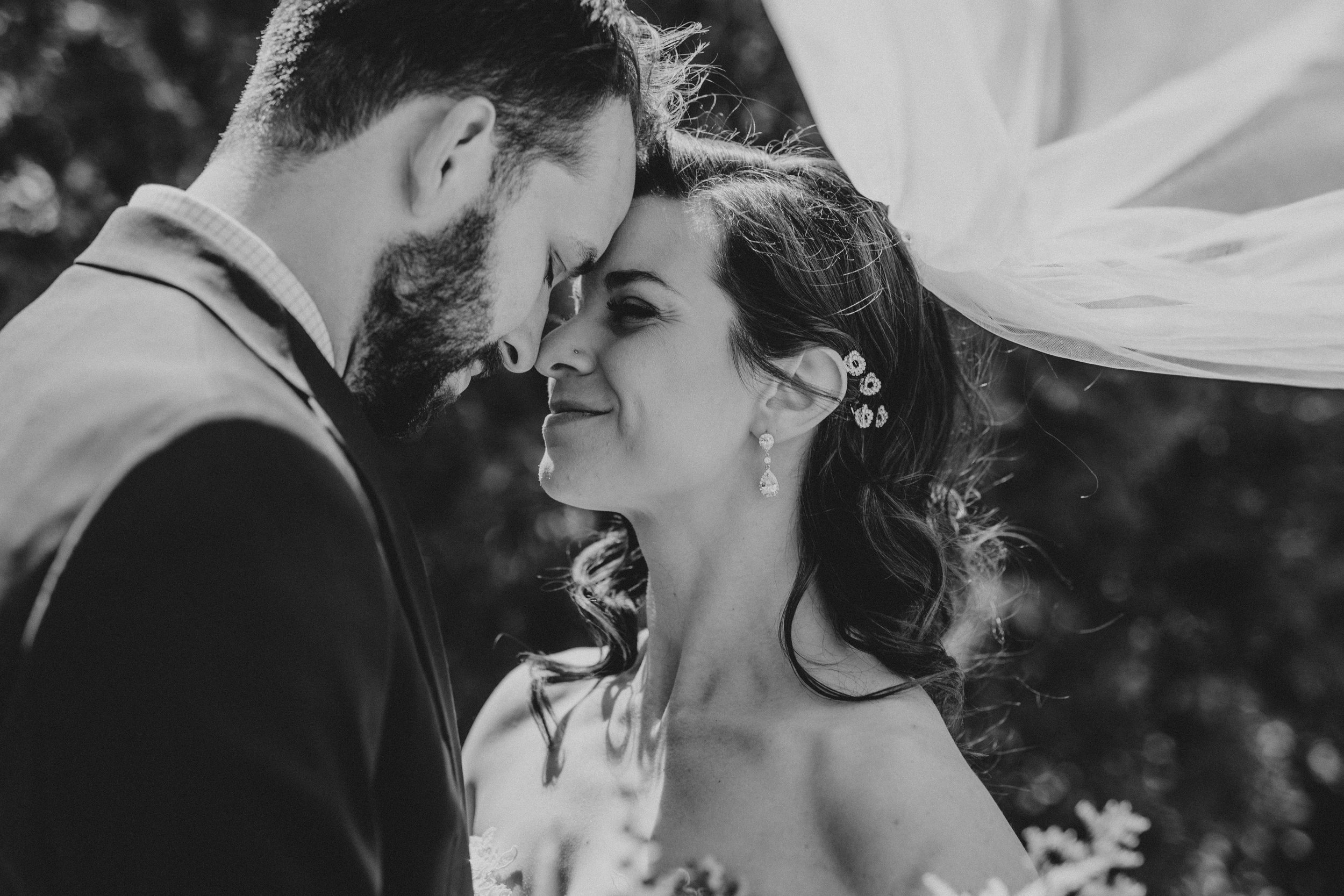 veil flowing, forehead touch | Russell Heeter Photography :: Minneapolis wedding planner Sixpence Events :: Nicollet Island Pavilion :: april wedding in Minnesota.jpg