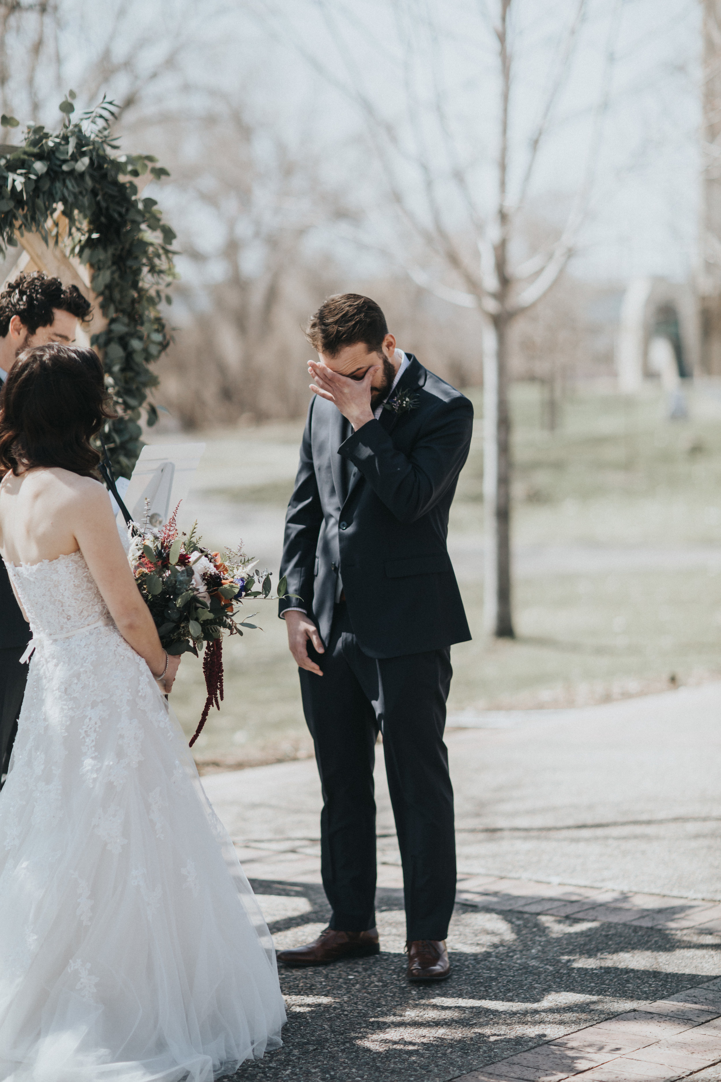 groom tearing up during vows | Russell Heeter Photography :: Minneapolis wedding planner Sixpence Events :: Nicollet Island Pavilion :: april wedding in Minnesota.jpg