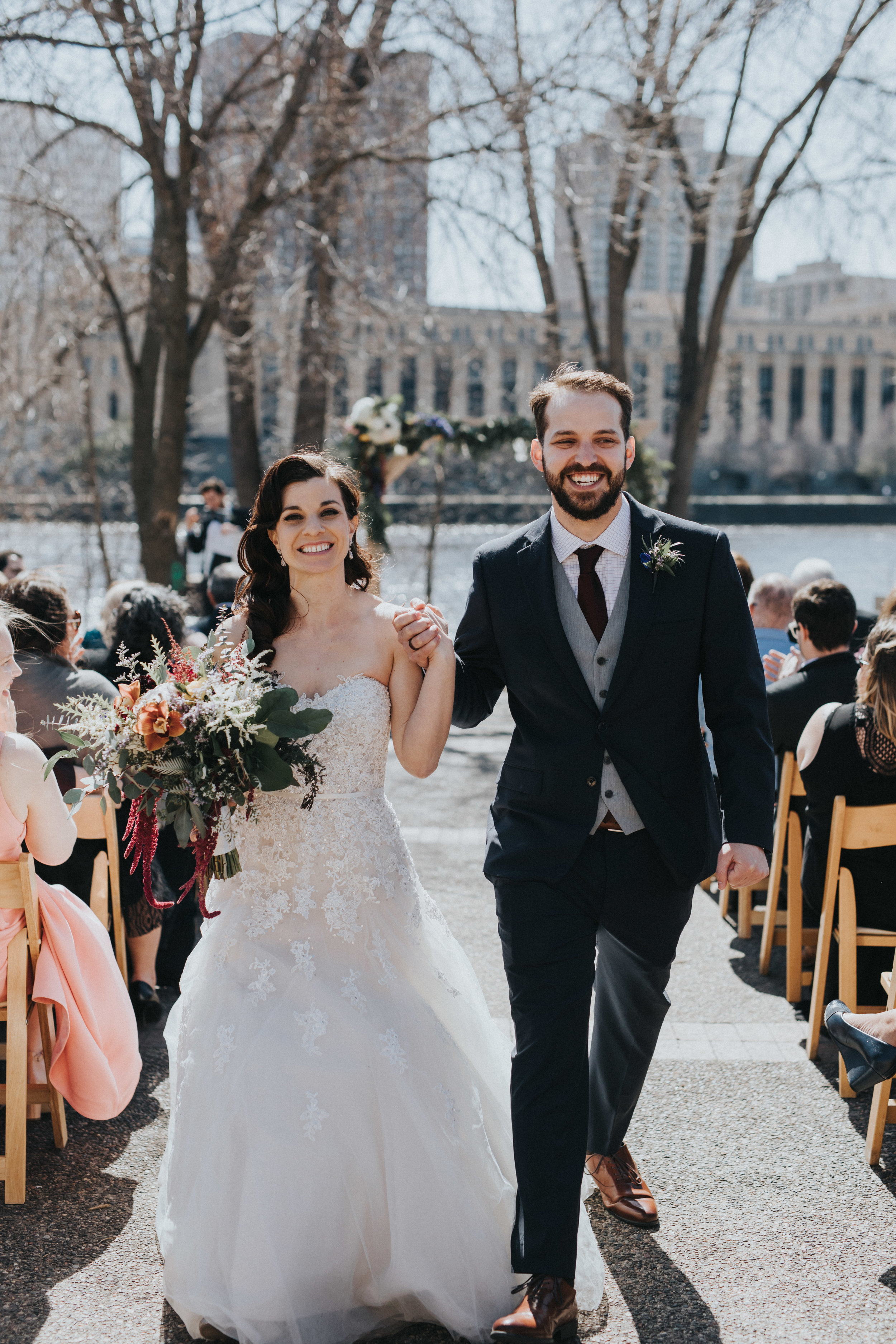 recessional | Mississippi river in the backdrop | Russell Heeter Photography :: Minneapolis wedding planner Sixpence Events :: Nicollet Island Pavilion :: april wedding in Minnesota.jpg