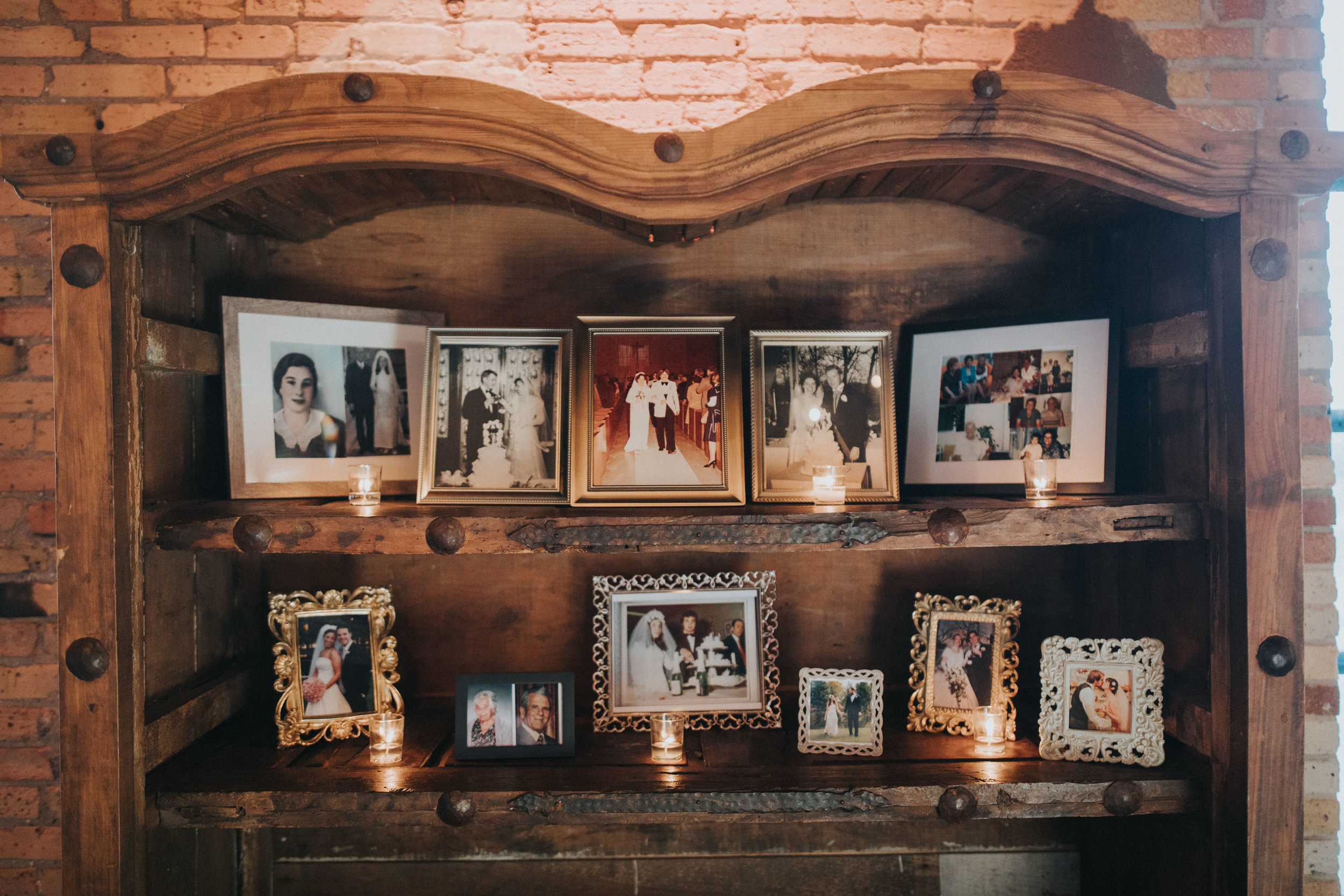 memorial wedding photo display in hutch at Nicollet Island | Russell Heeter Photography :: Minneapolis wedding planner Sixpence Events :: Nicollet Island Pavilion :: april wedding in Minnesota.jpg