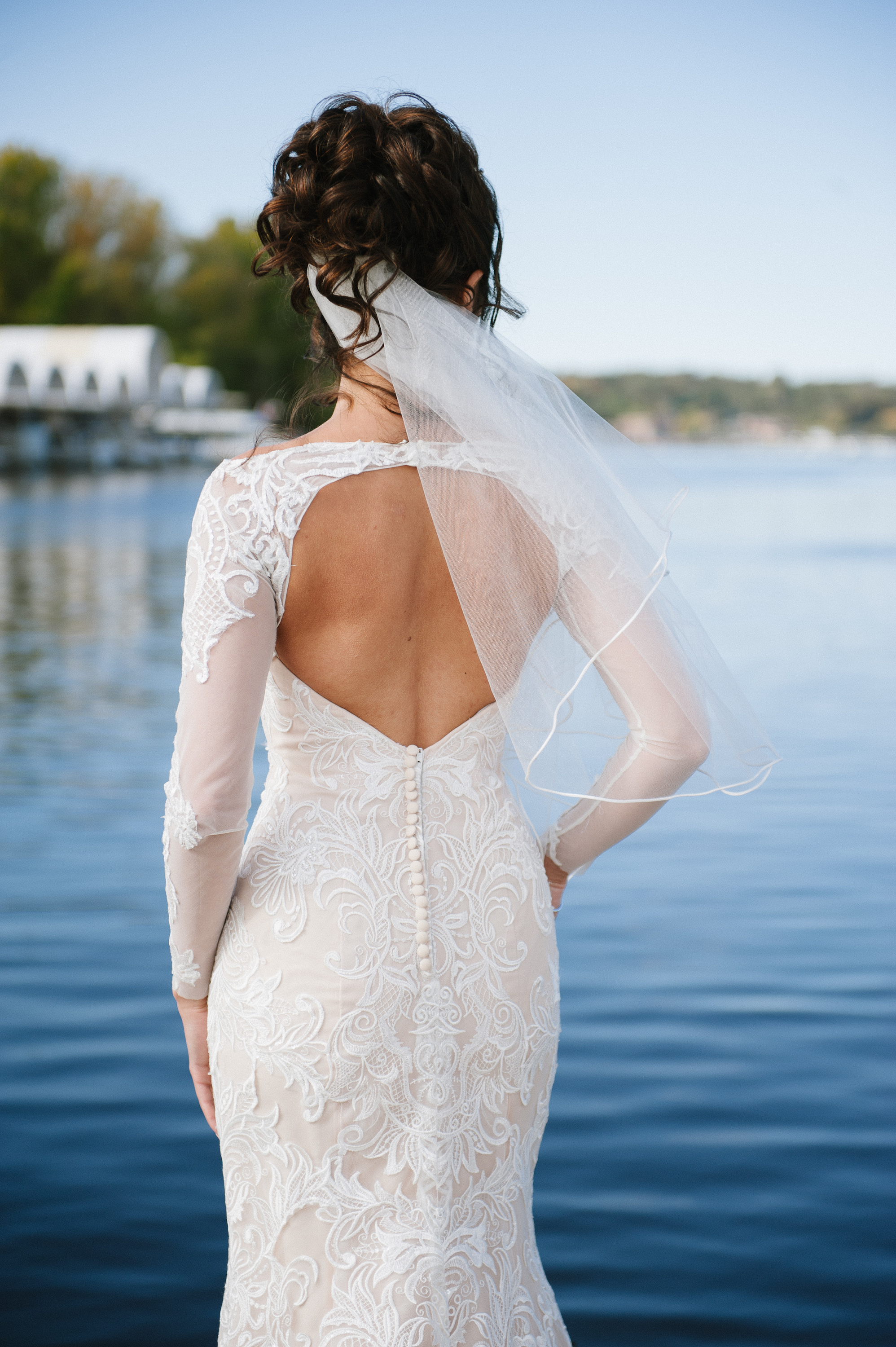 key hole wedding dress with sleeves on the dock | Dillinger Studios Minneapolis Photographer | Mexican American fusion wedding | Sixpence Events & Planning Minnesota wedding planner .jpg