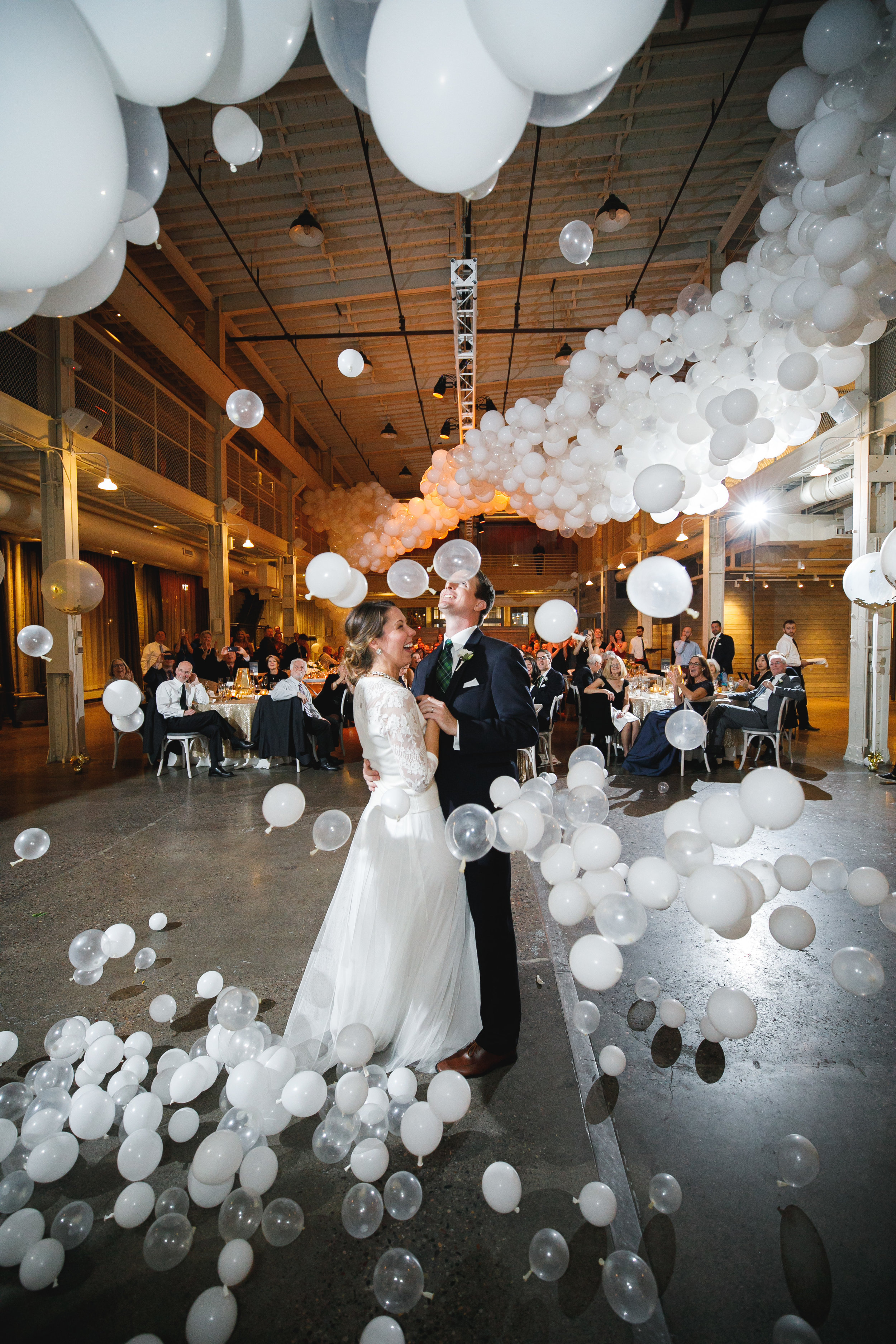 Brovado Wedding Photography | Machine Shop Minneapolis | Sixpence Events Day of Coordinating | balloon drop during first dance | Girl Friday Creative.jpg