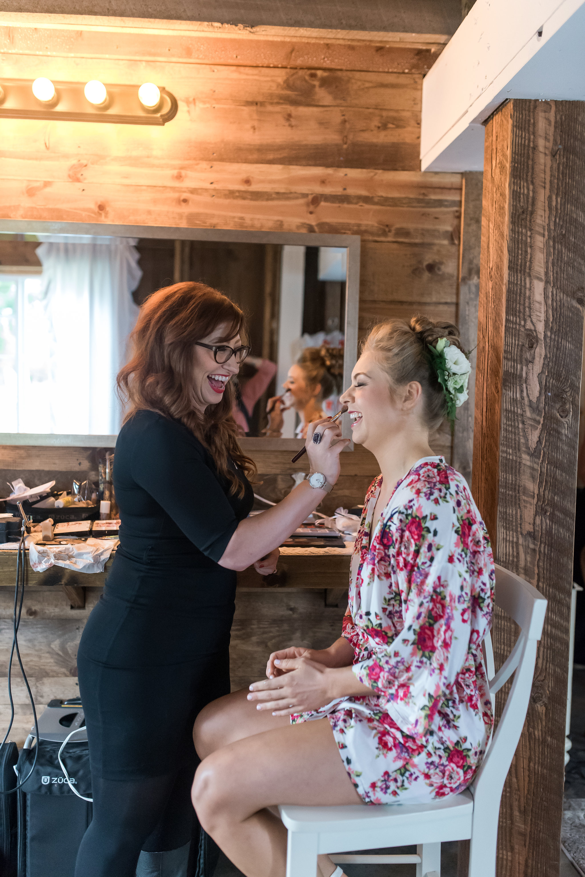 Carrie and Dave // Bloom Lake Barn // Kelly Birch Photography // Bride getting ready in floral print white robe // Brett Dorian Hair and Makeup // bridal getting ready room // Sixpence Events and Planning day of coordinating