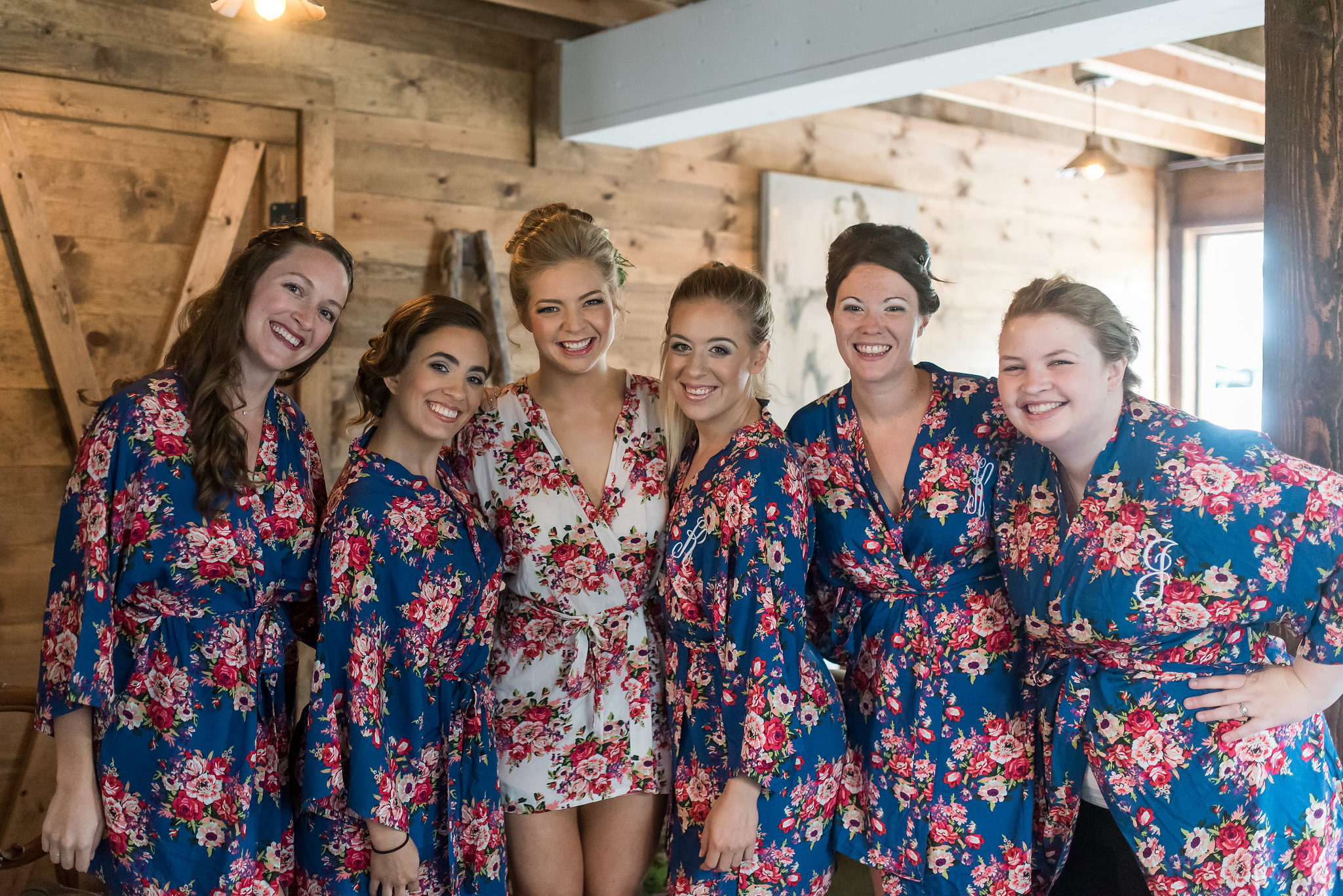 bridal party getting ready photo in matching robes navy with floral printKelly Birch Photography :: Bloom Lake Barn :: Sixpence Events Minnesota wedding planner :: A Vintage Touch Weddings :: Brett Dorian.jpg