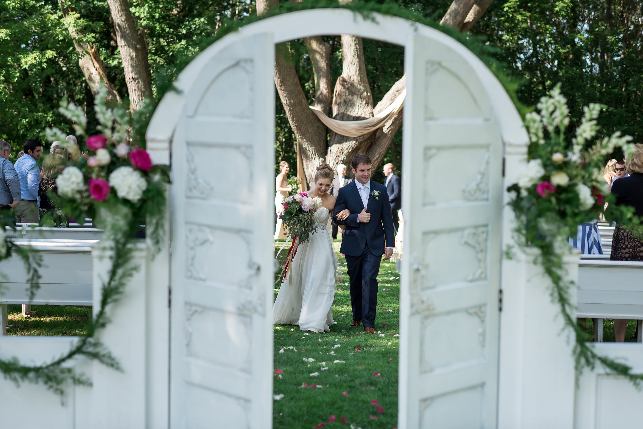 just married peek through white arch doors | Kelly Birch Photography :: Bloom Lake Barn :: Sixpence Events Minnesota wedding planner :: A Vintage Touch Weddings :: Brett Dorian.jpg